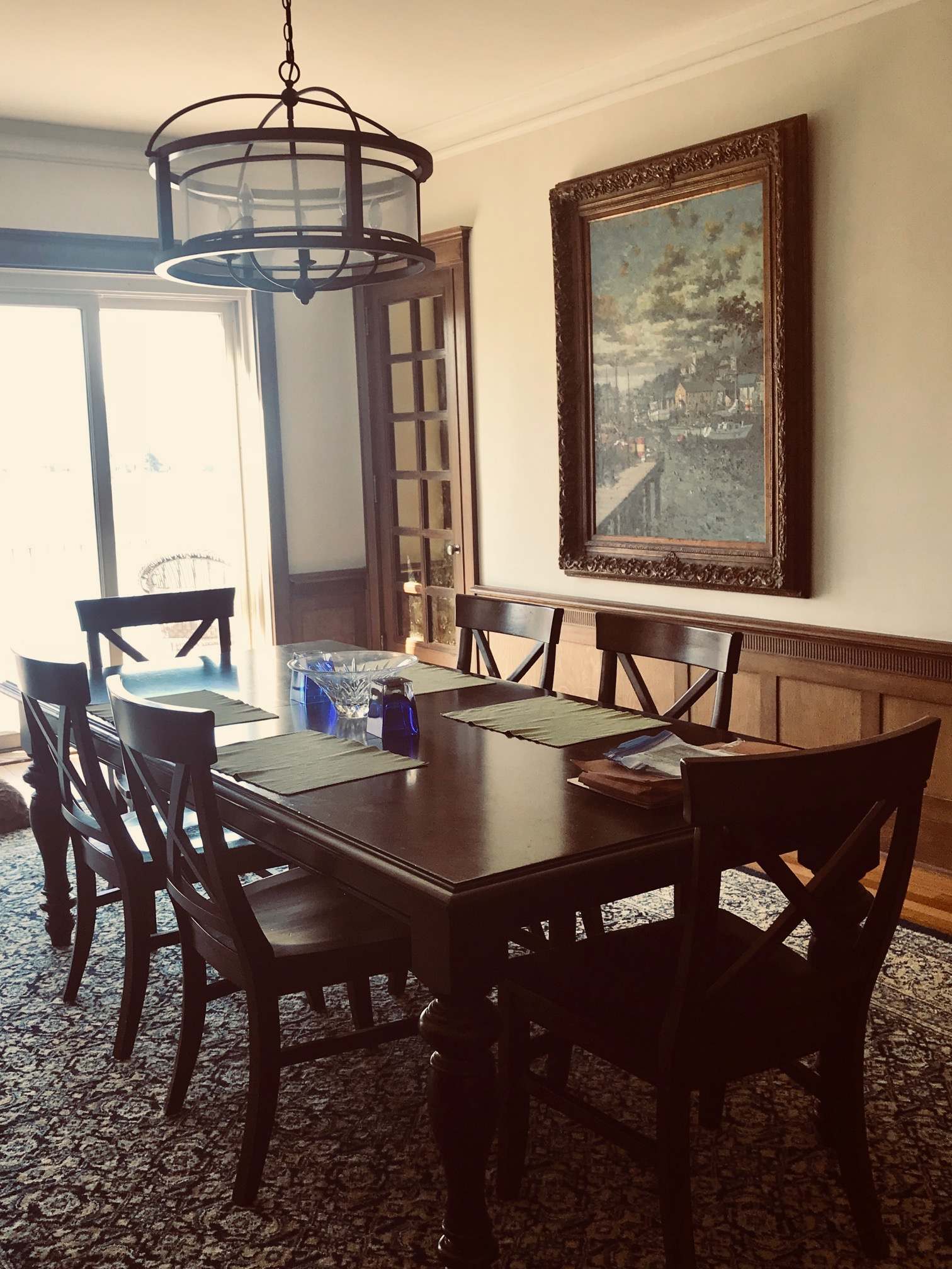 Dining Room with gilt frame and cabinets with gold tinte glass