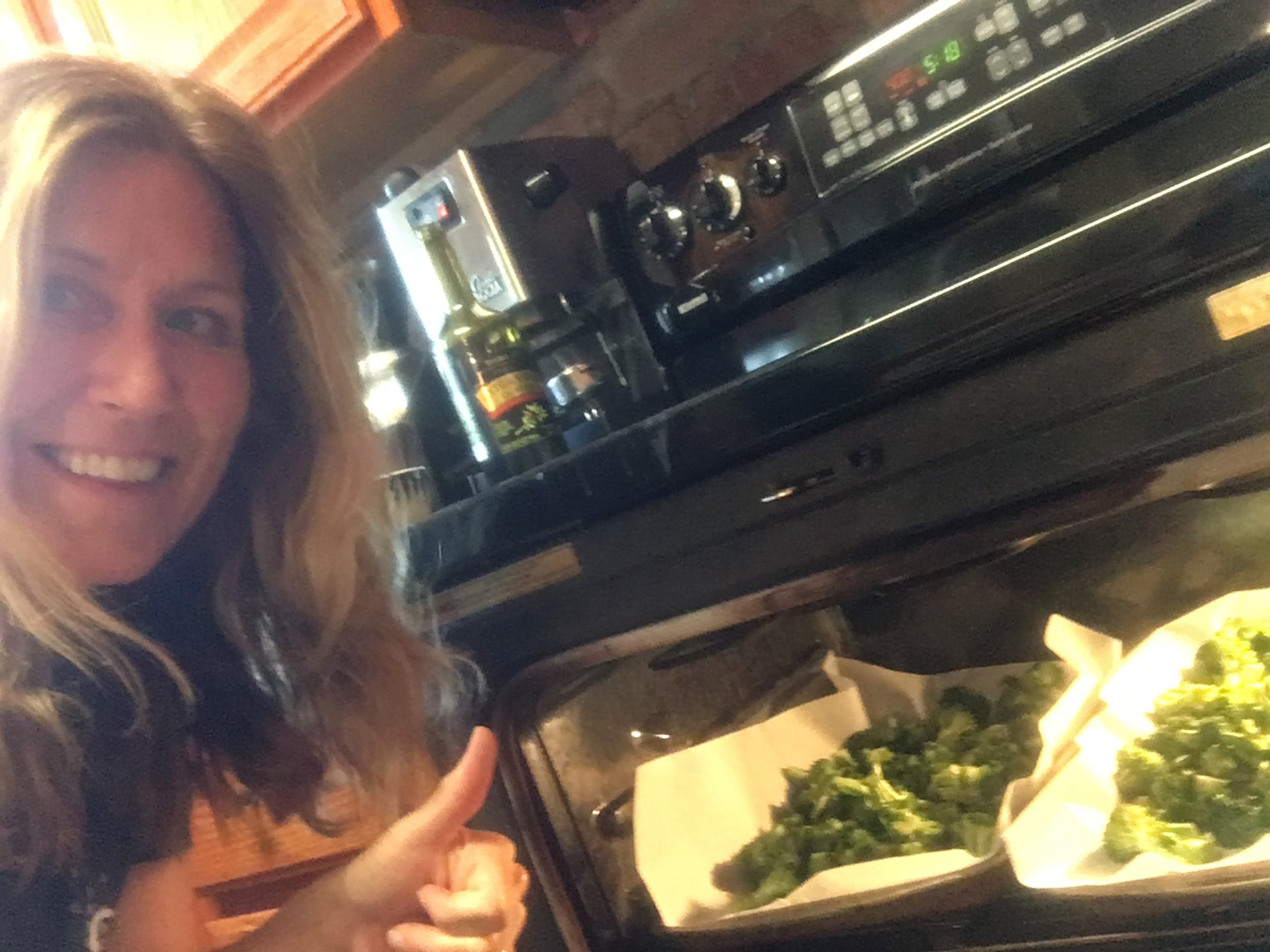 Debbie roasting broccoli to go with tofu and peanut sauce, as a move toward her values-based goal of a more plant-based diet!
