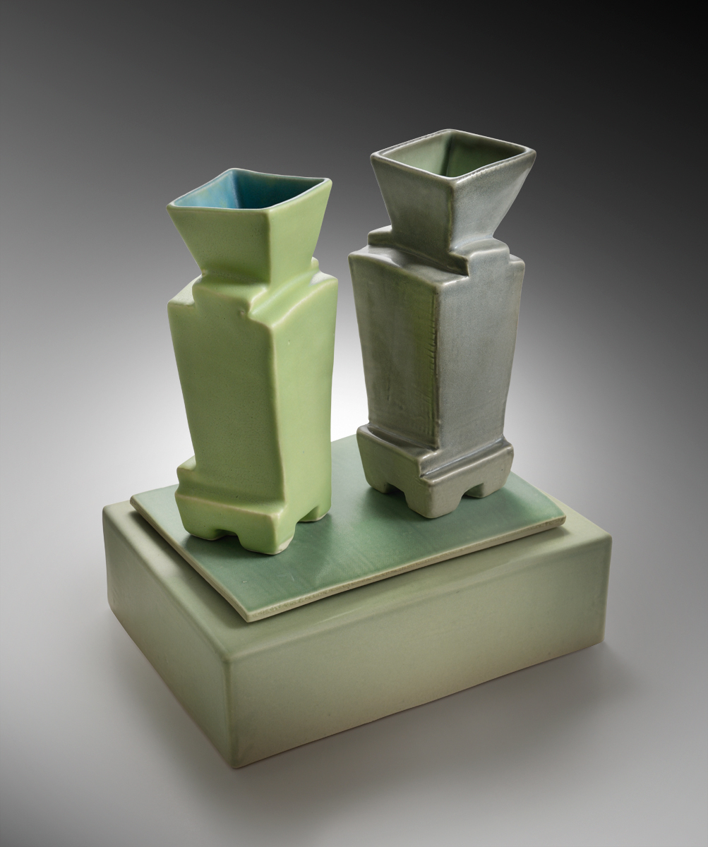 Two Vases On Green Vase