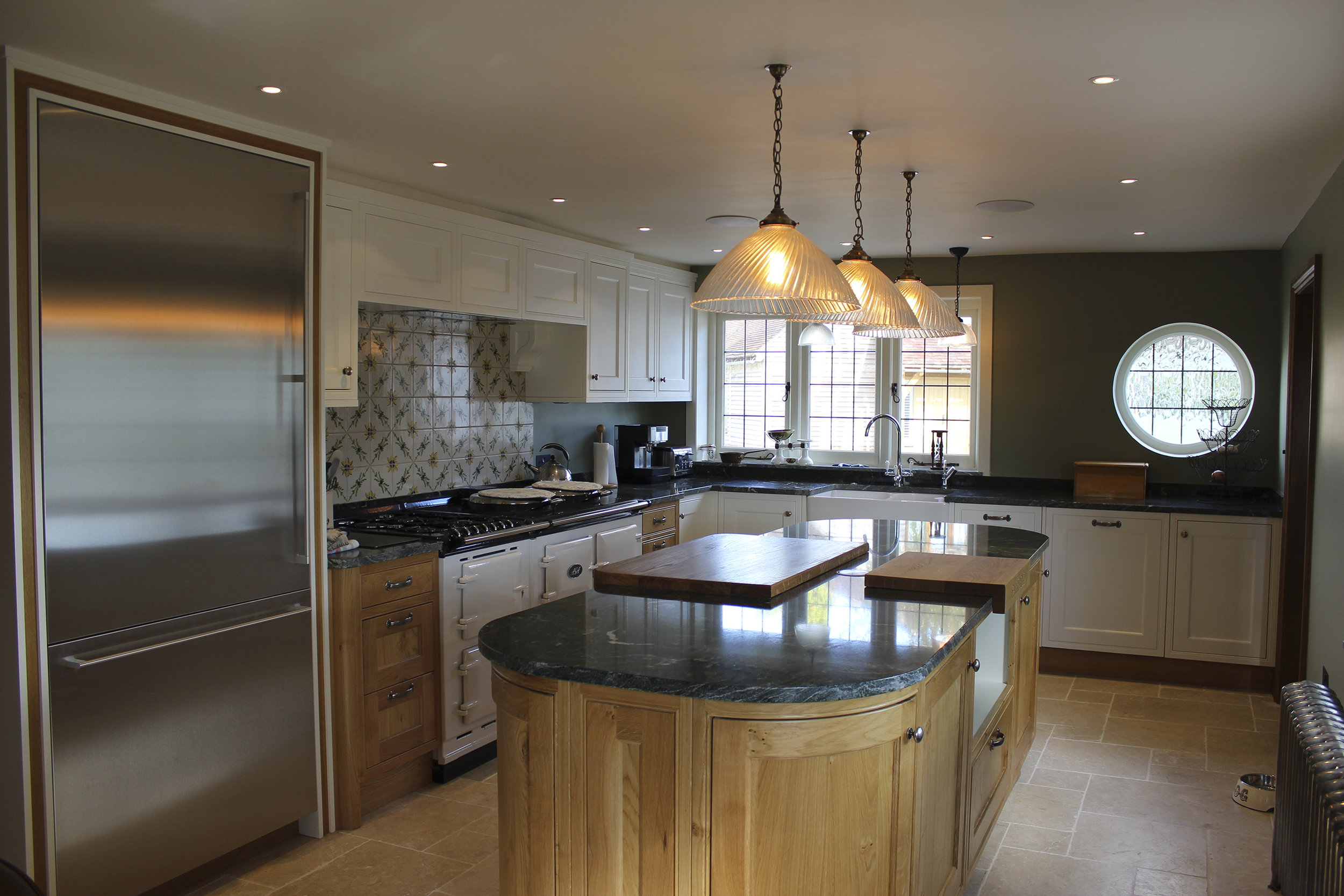Kitchen design and build, including flooring, granite work surfaces and handmade cabinets units.