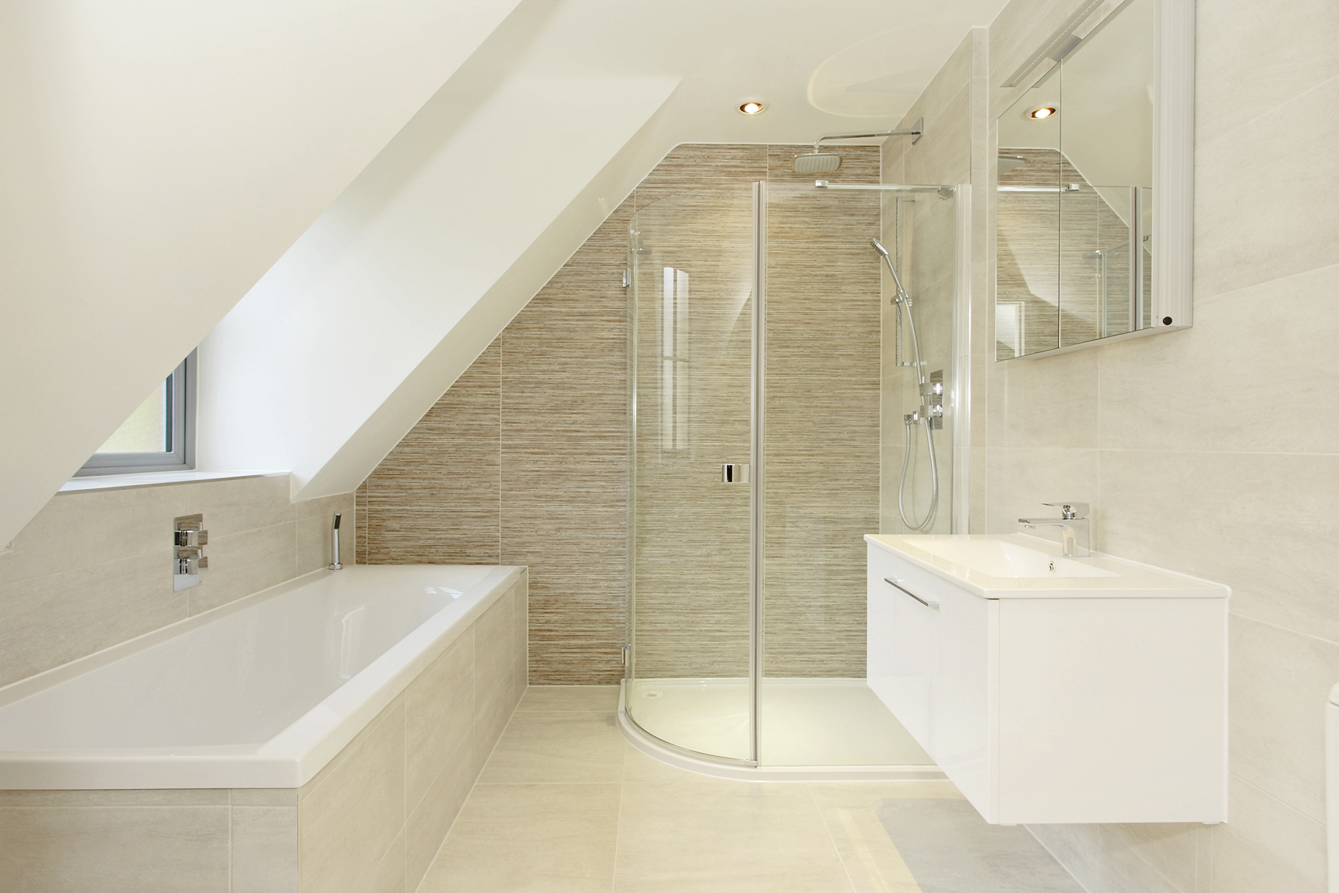 Fully fitted bathroom incorporating porcelain tiling, quadrant shower unit and wall hung basin unit.