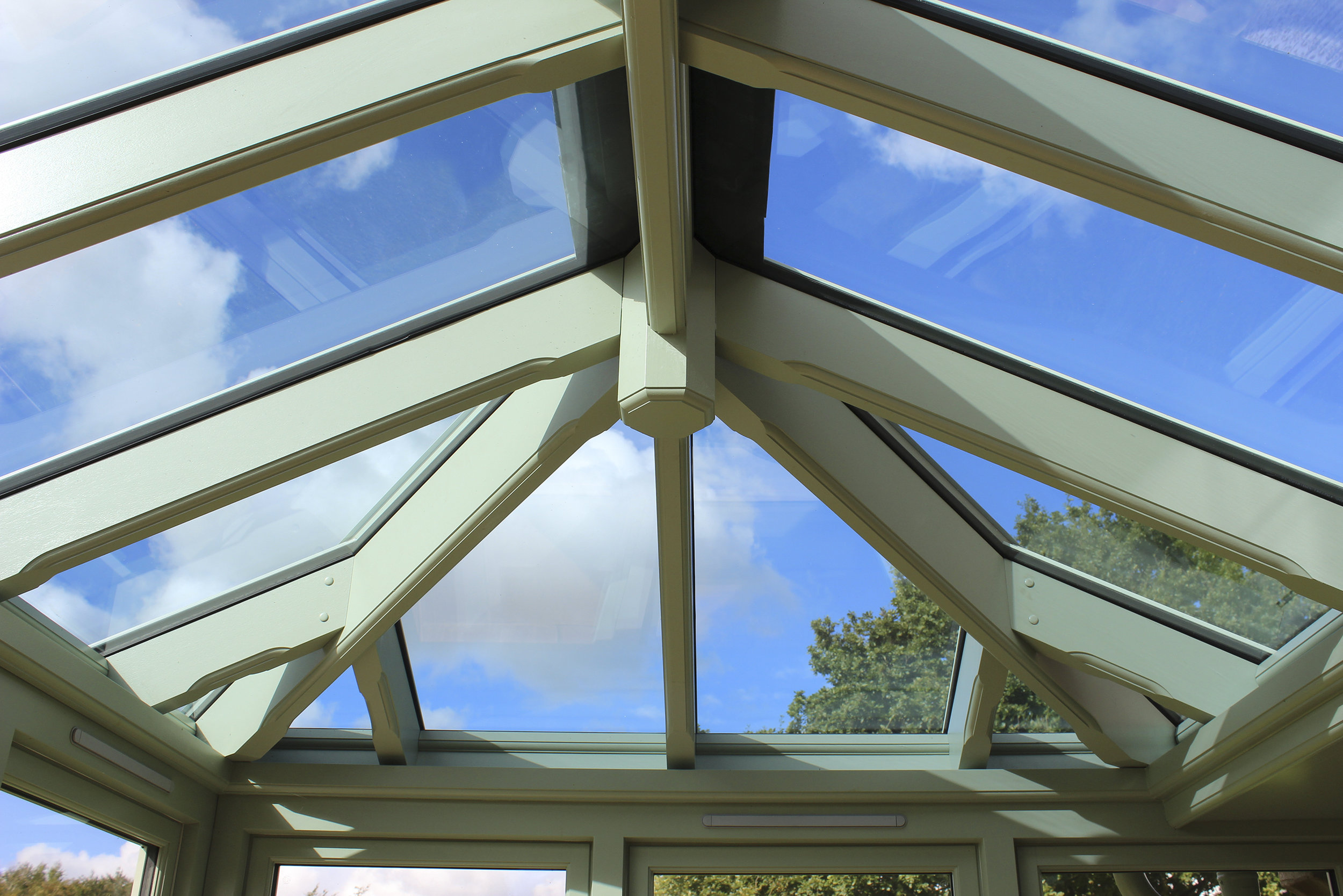 Hard wood conservatory painted to match all external woodwork of the property.