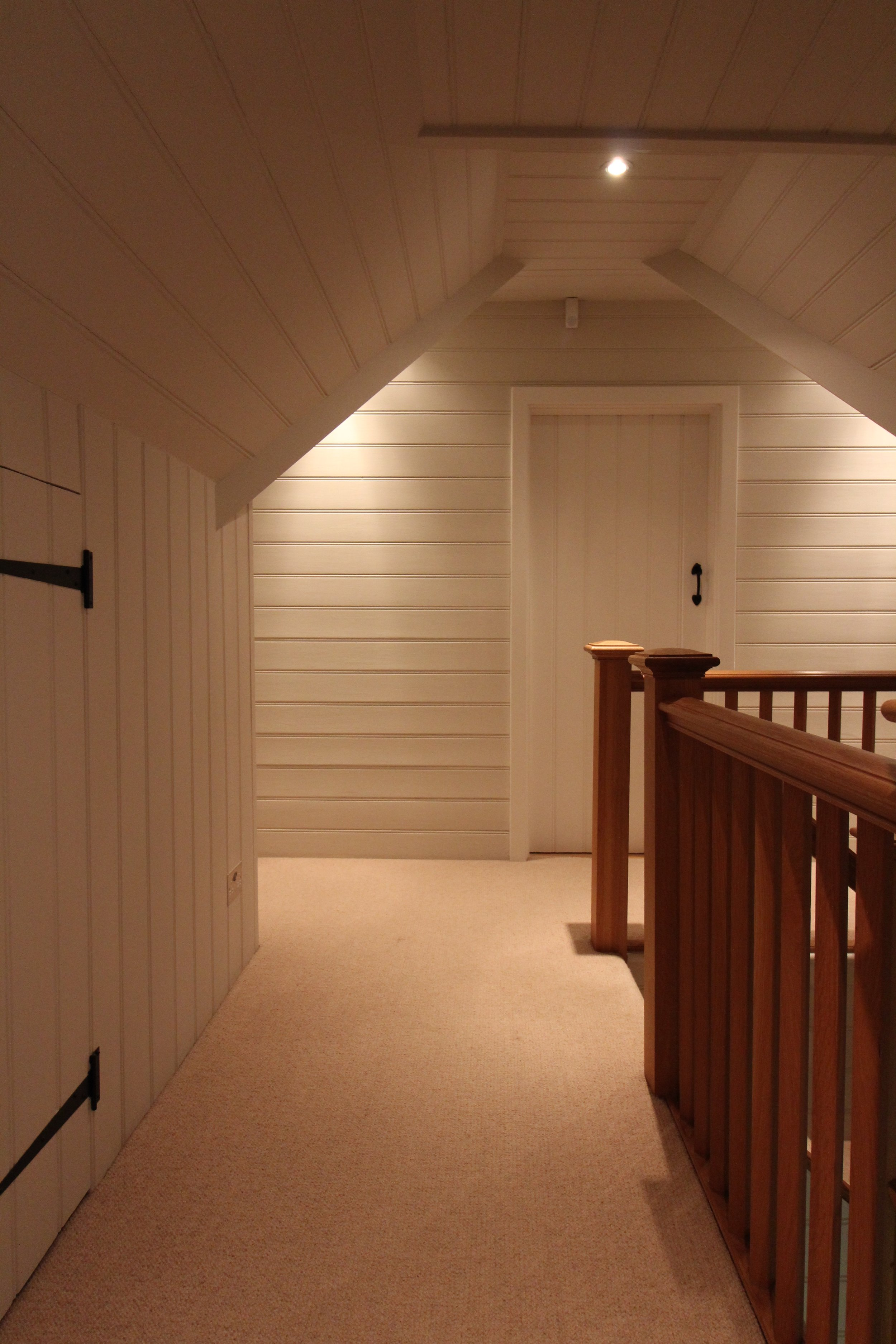 Tongue and groove wall panelling, carefully repaired and decorated in Farrow and Ball paint.
