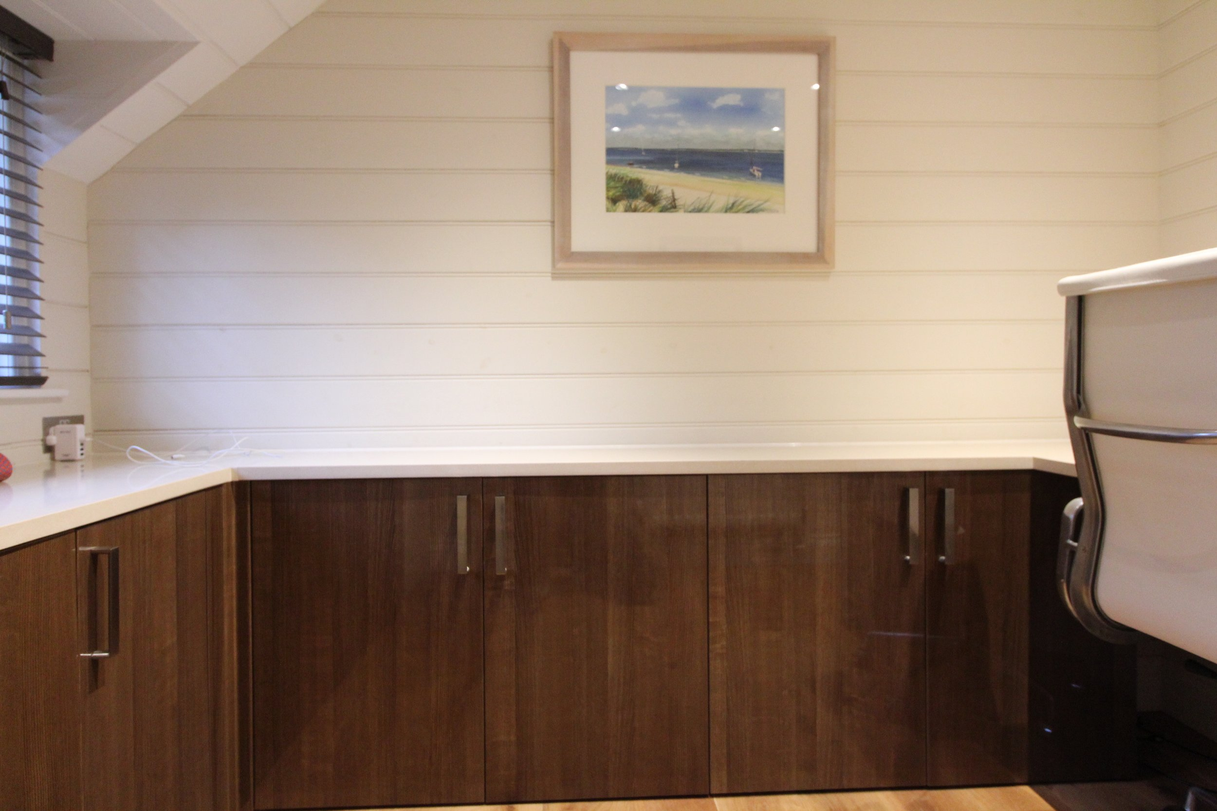 Silestone worktops create a clean workspace over storage cabinets.