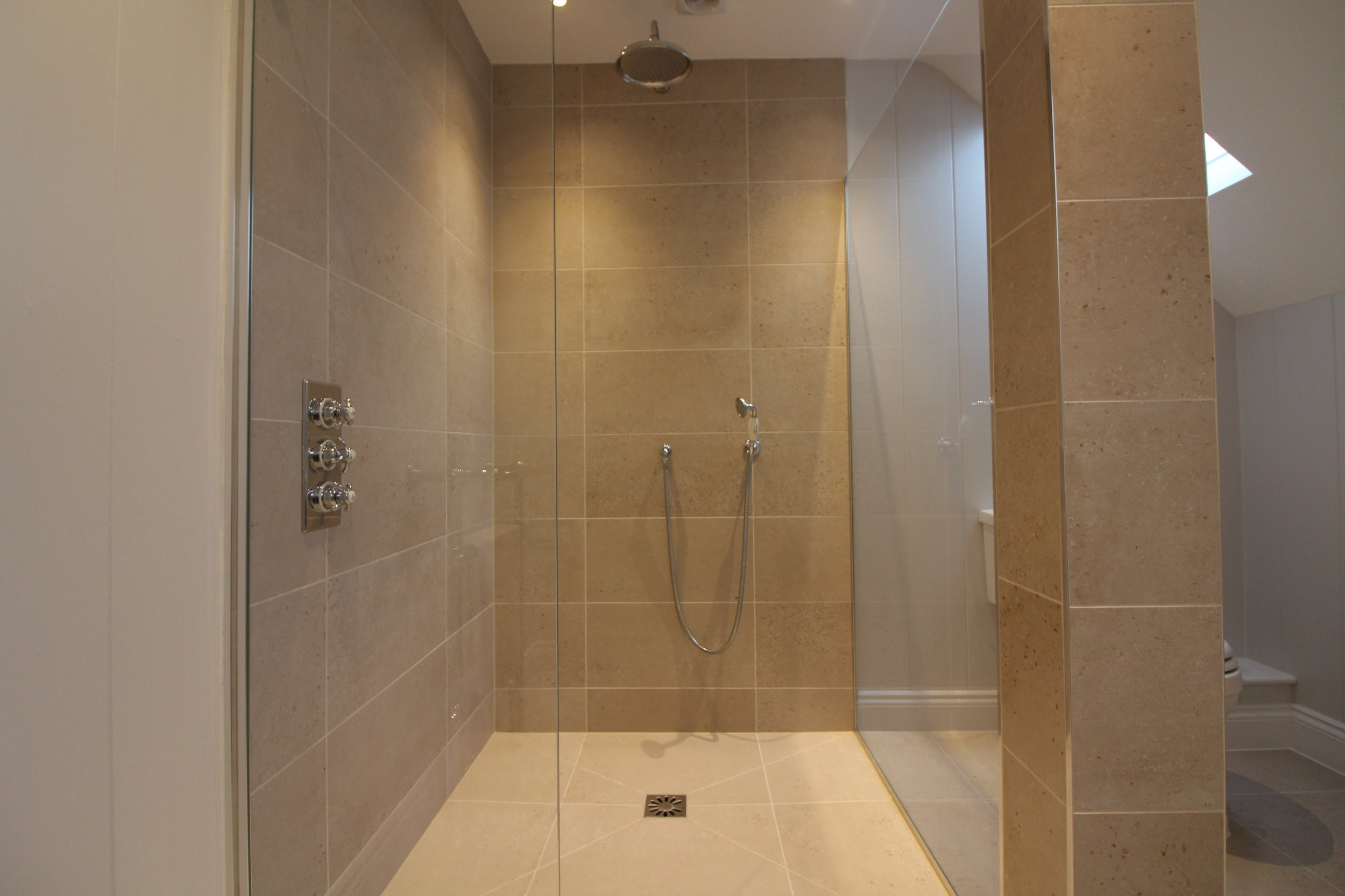 Porcelain tiles and Burlington fittings to give that classic wet room look.