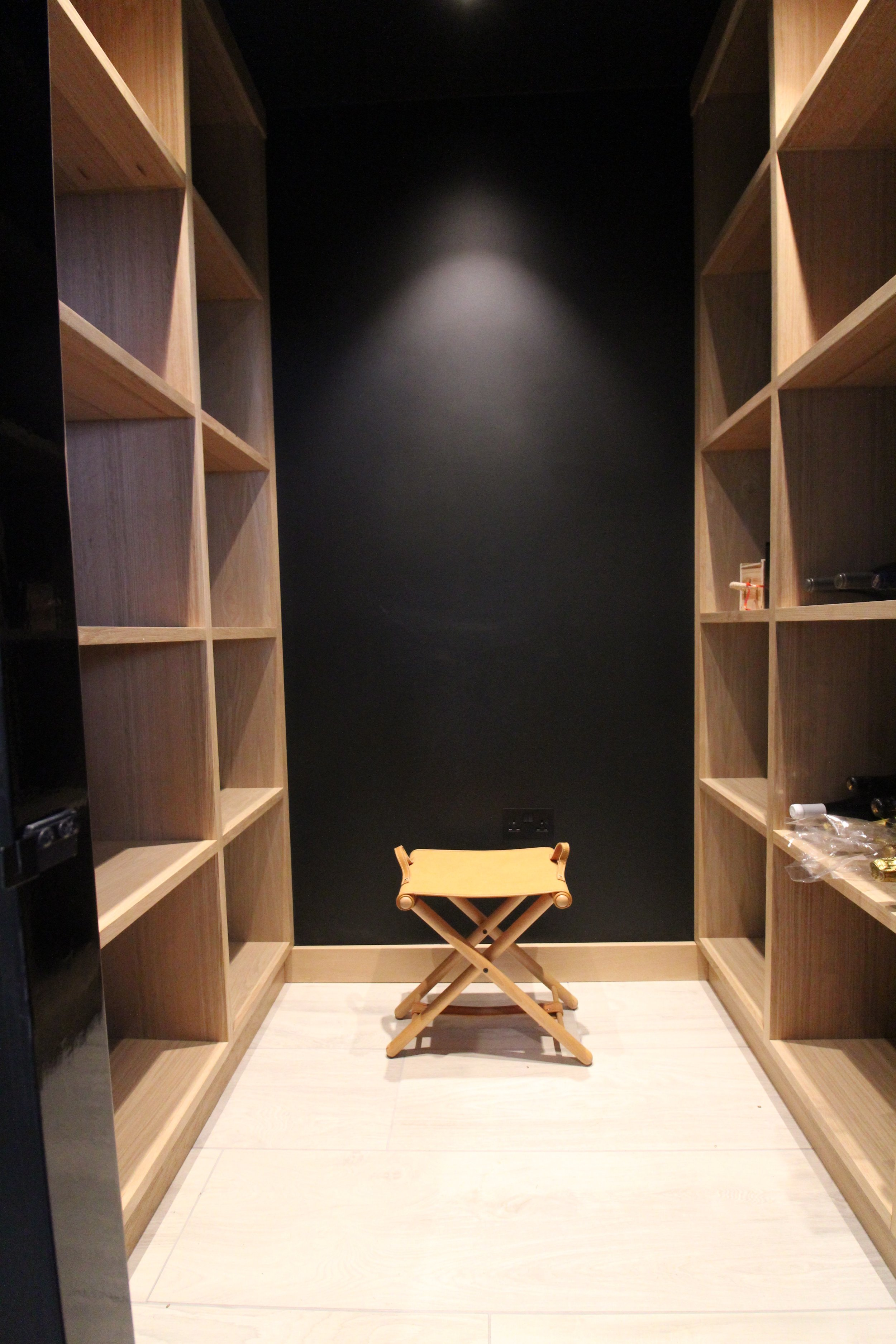 Joiner-made oak shelving can hold up to 400 bottles of wine or champagne.
