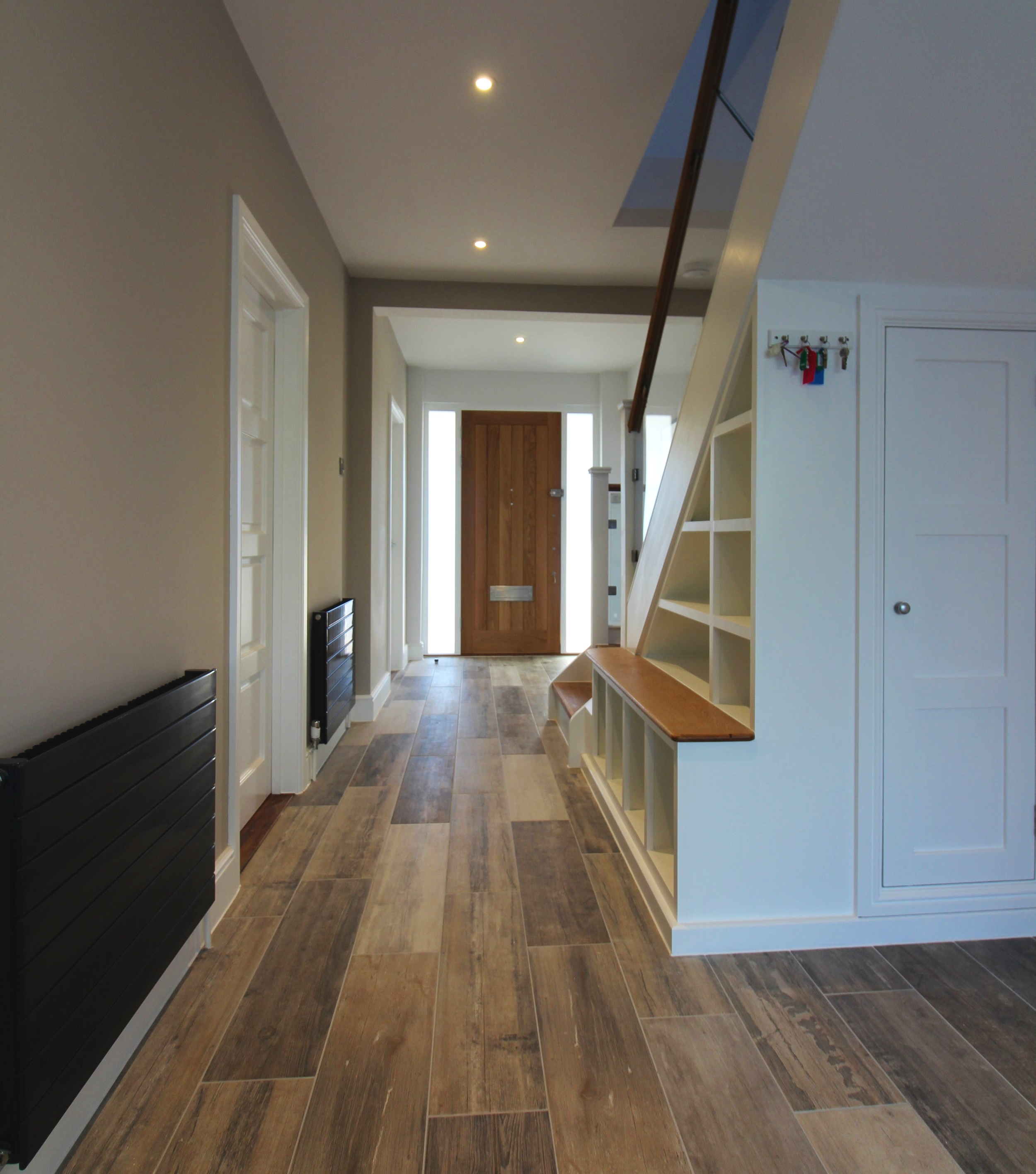 The existing staircase was revamped, adding oak treads and handrails, with glass balustrade. Fully-integrated LED spotlights created low level lighting.
