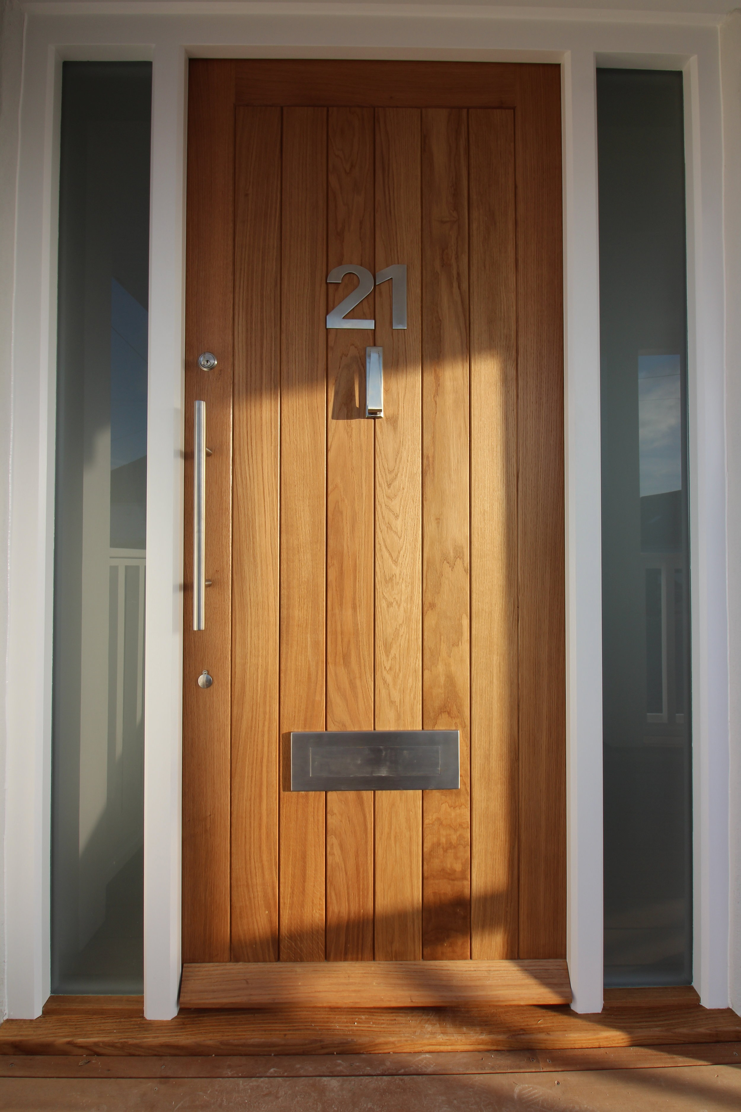 Hardwood contemporary door, with frosted glass either side to maximise natural light.