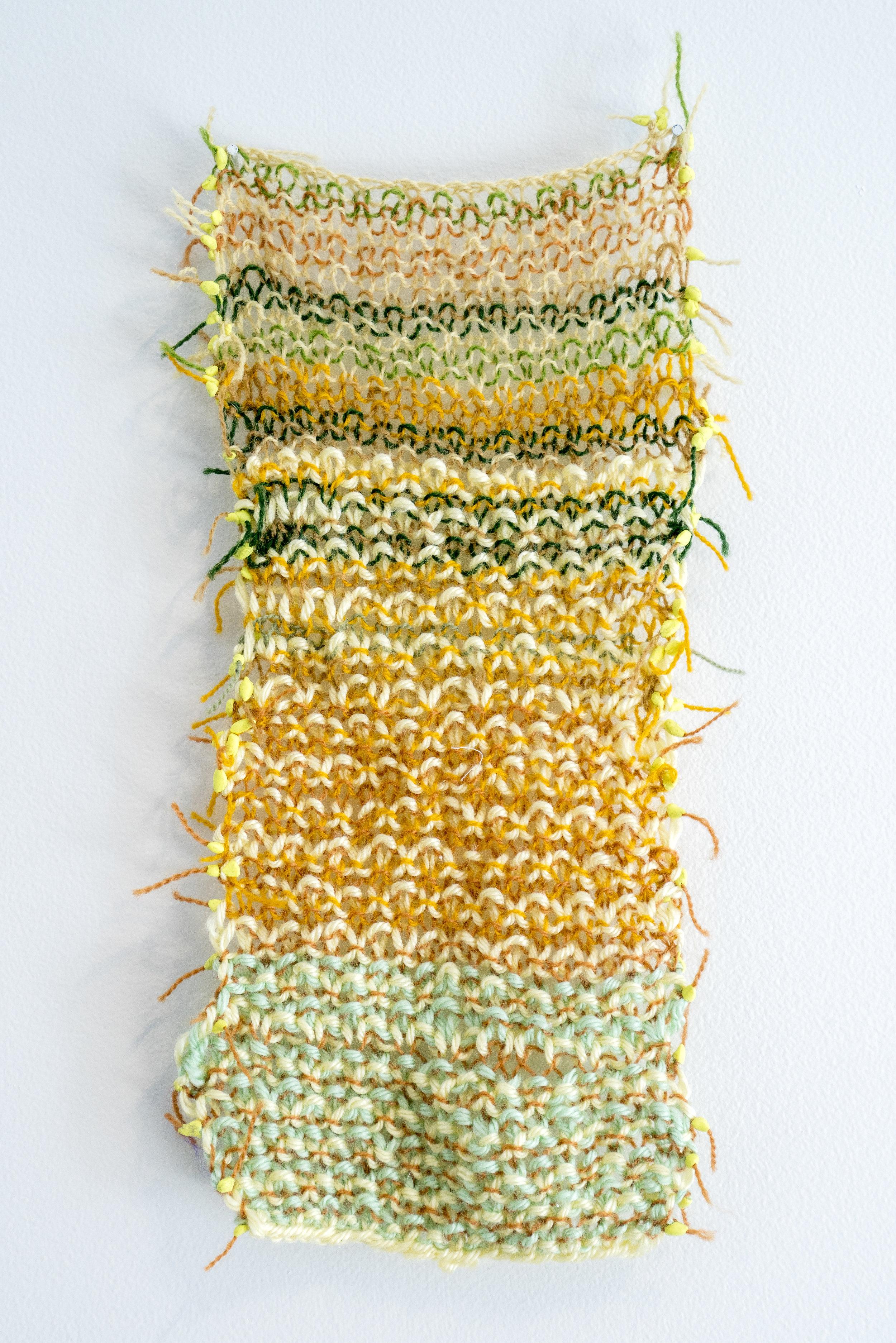 "Horizon Stripes   2016  Wool yarn, acrylic yarn, modeling clay.  13"" x 4"""