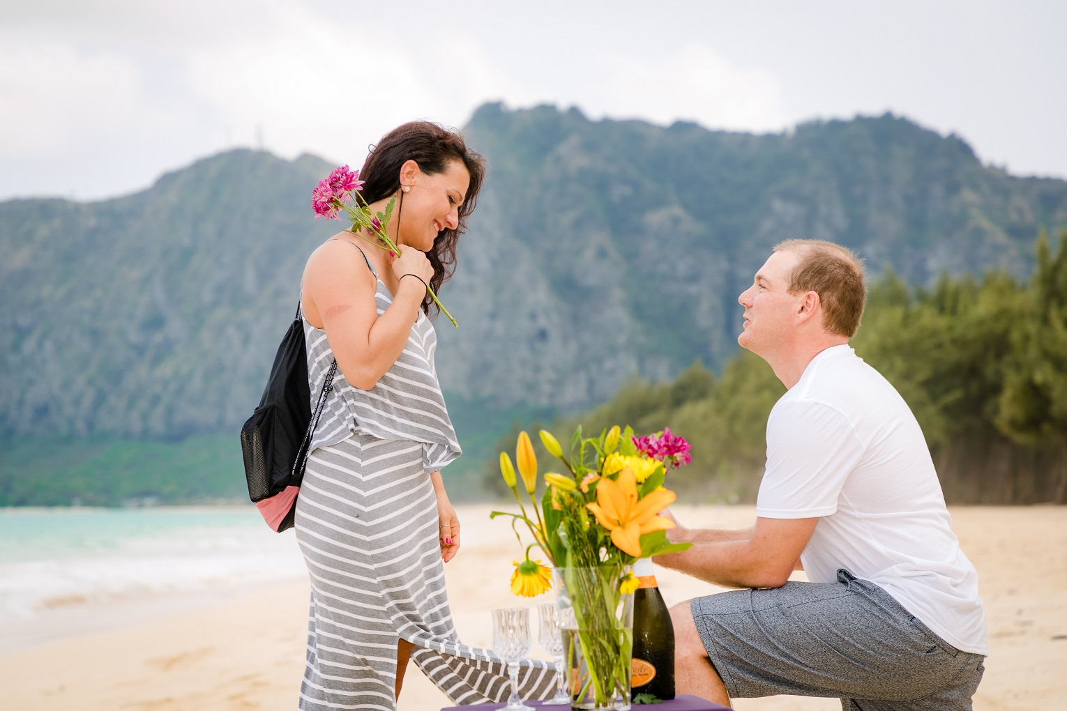 Secret rendezvous on the beach for a romantic surprise proposal!