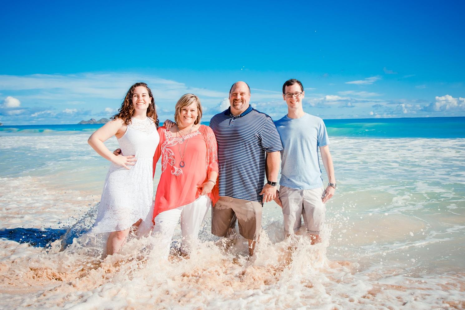 family photo ocean beach waves oahu hi