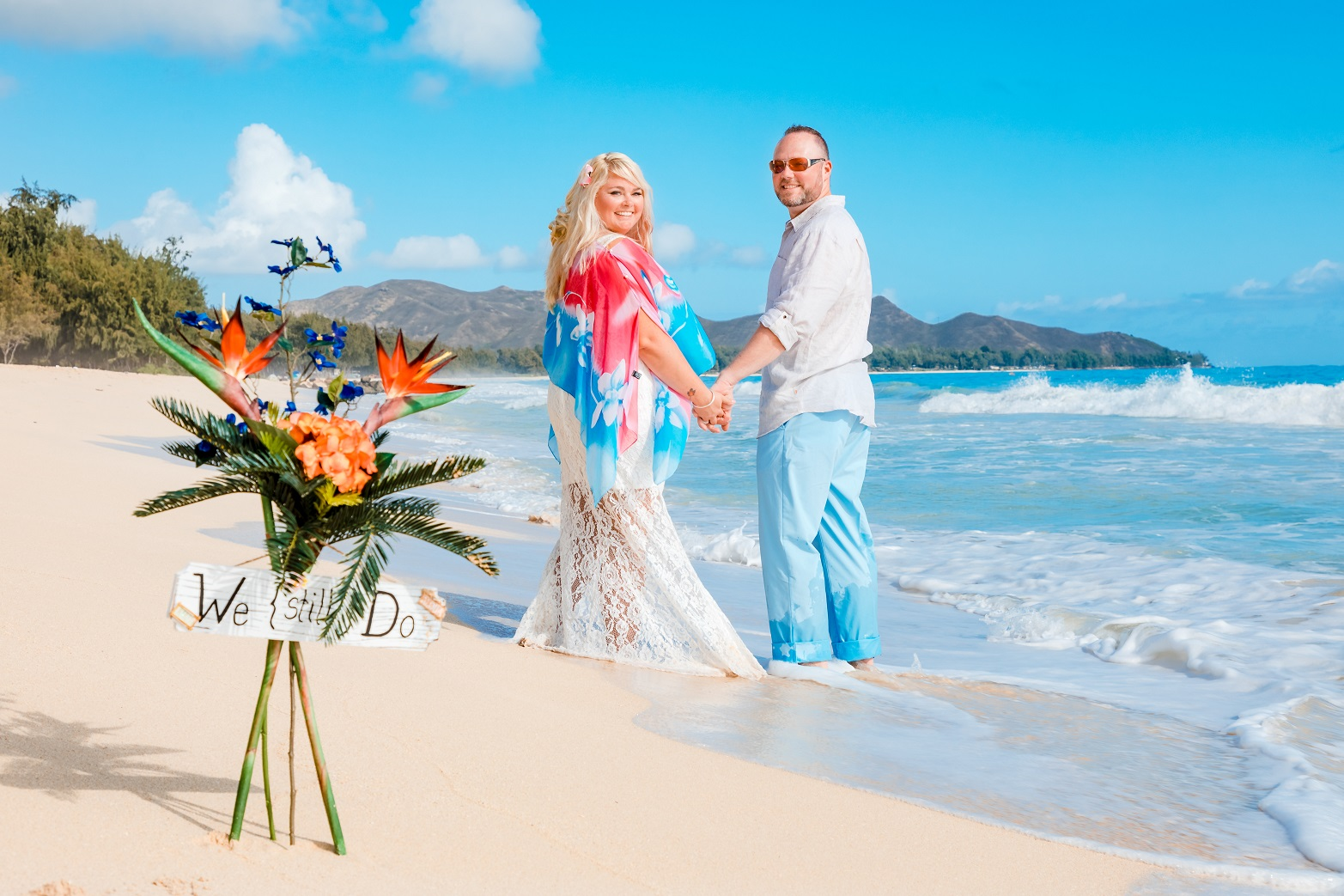 couples anniversary portrait on the beach we still do vow renewal