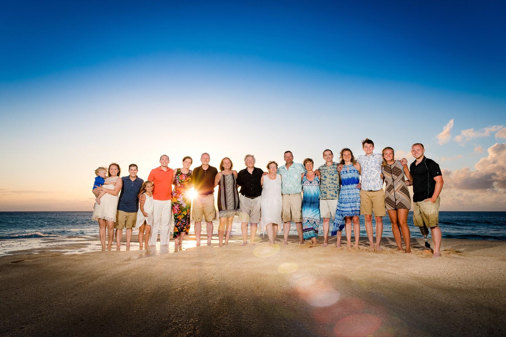 family sunset portrait sun flare beach photographer
