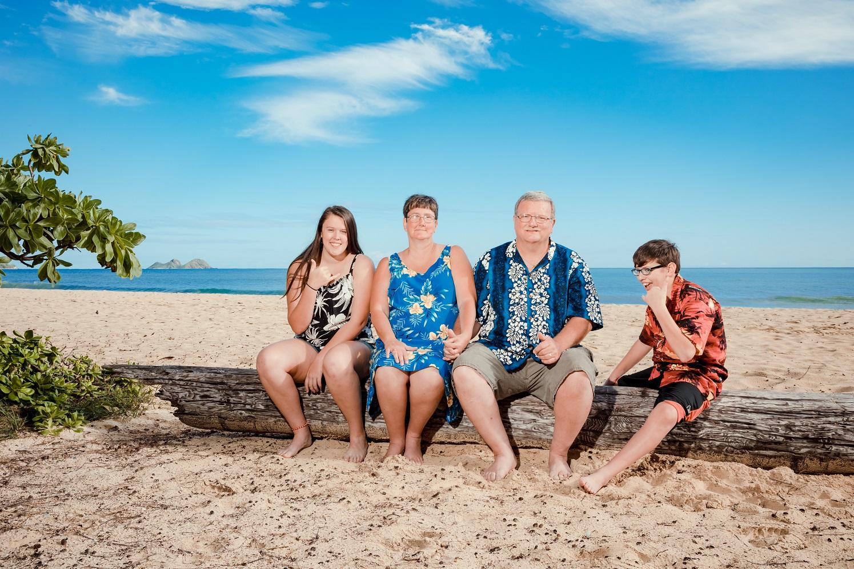 family photo on log on beach waimanalo oahu