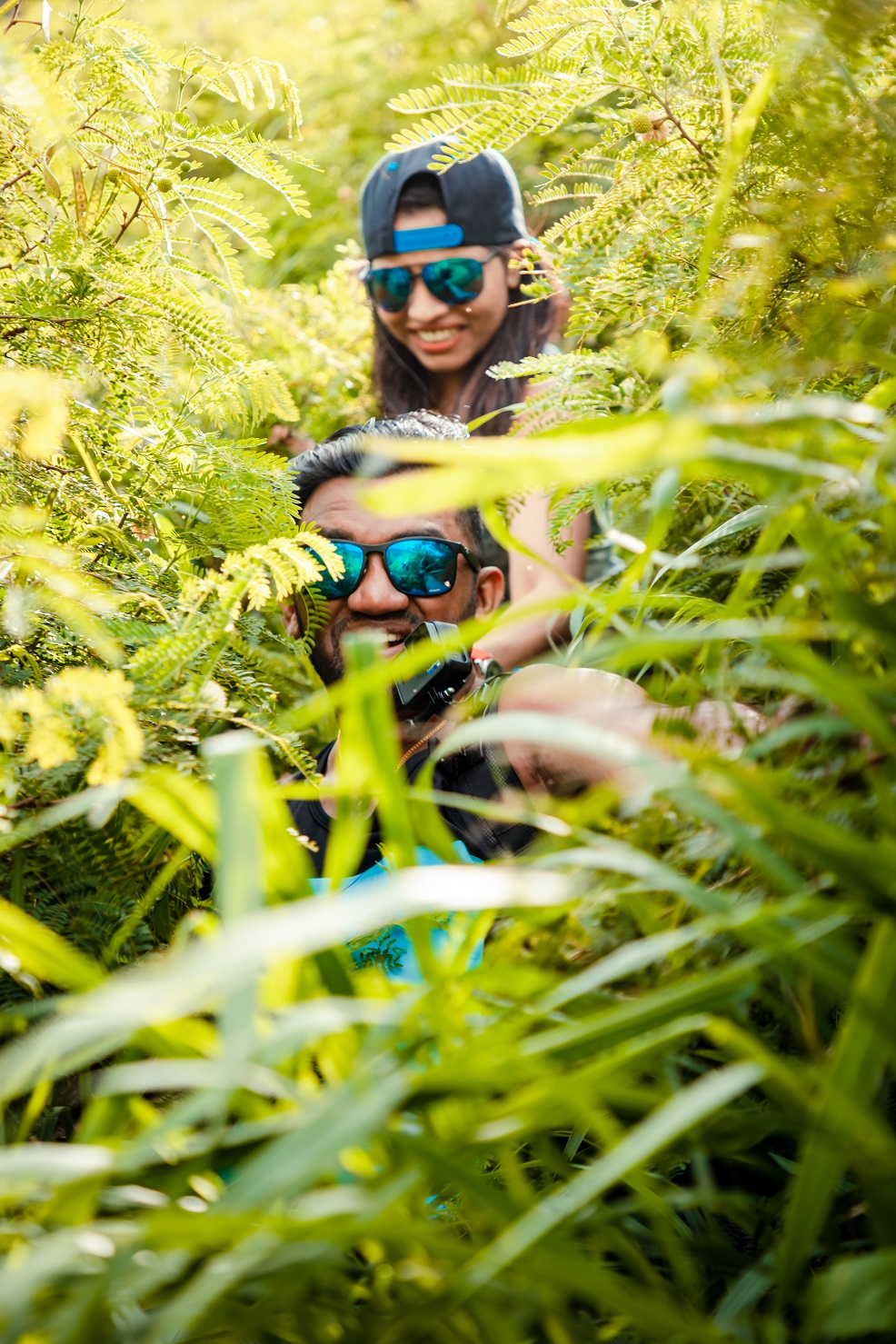 couples photo hiking an overgrown trail