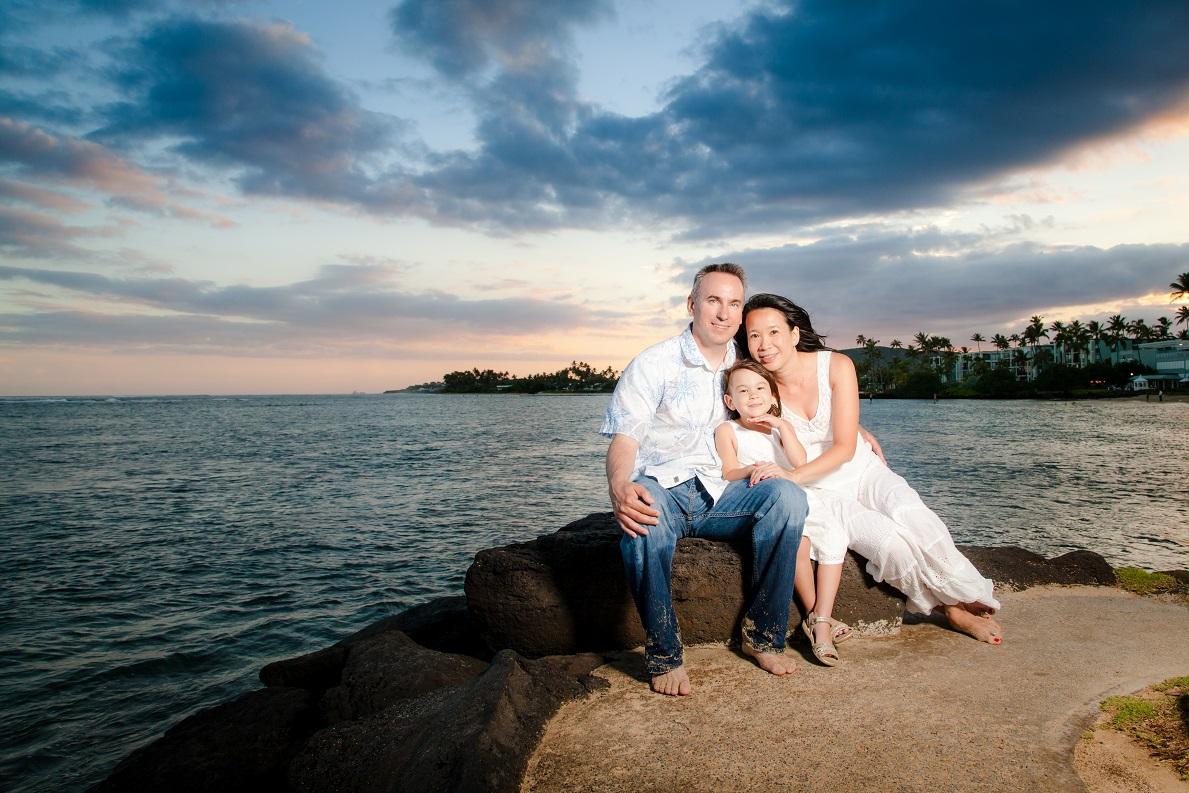 family sunset portrait palm trees ocean