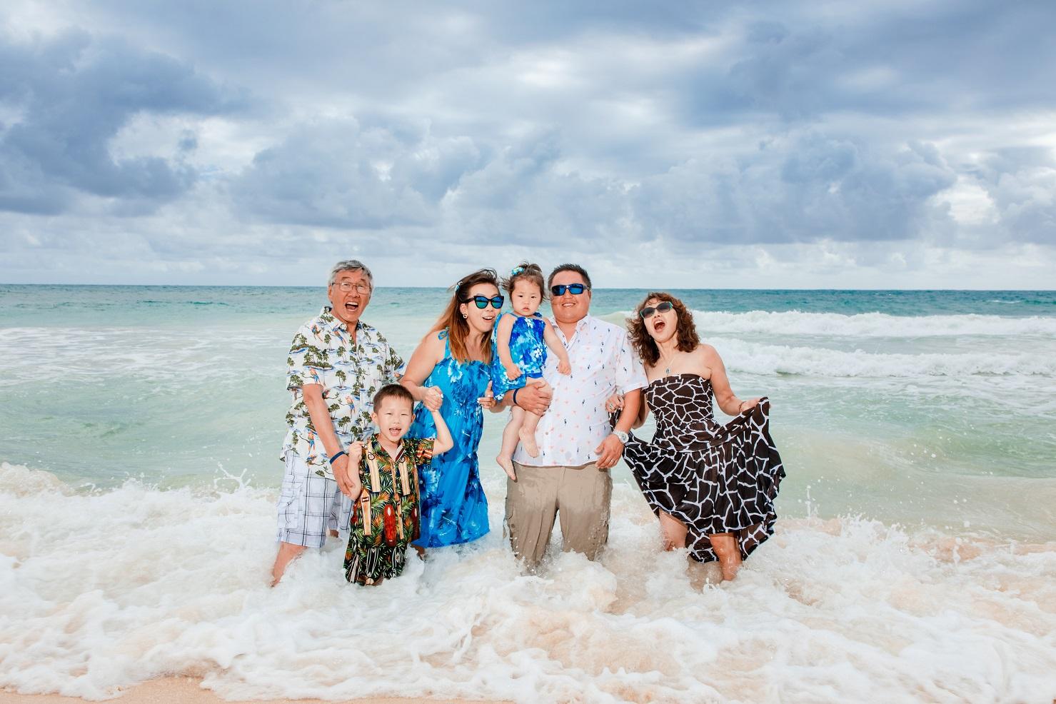 family portrait in the ocean oahu hawaii