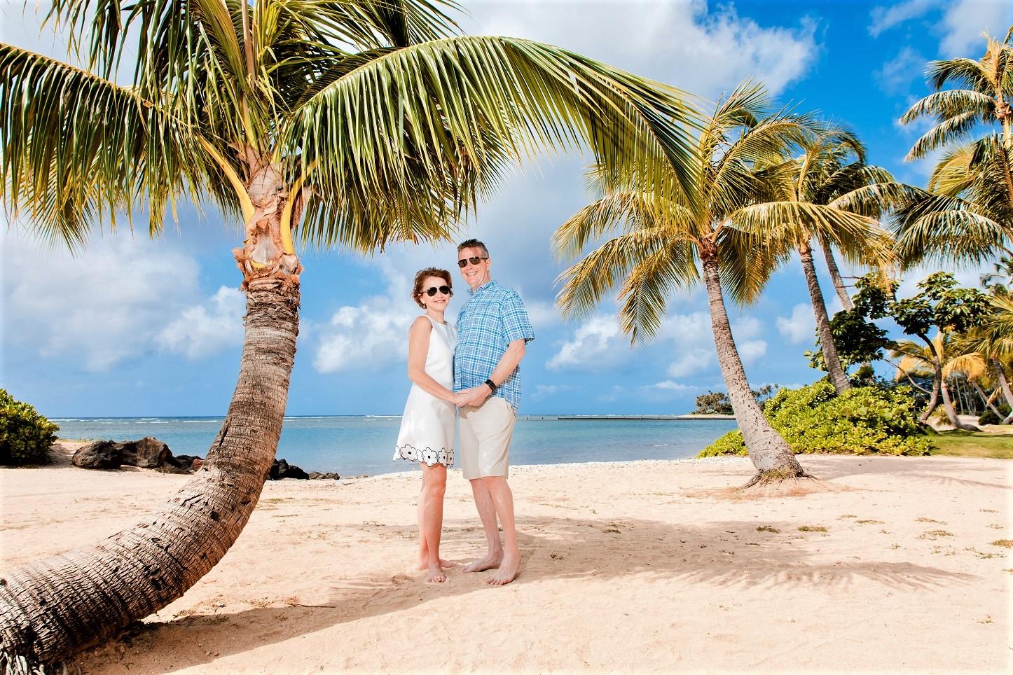 couples beach palm tree hawaii anniversary portrait