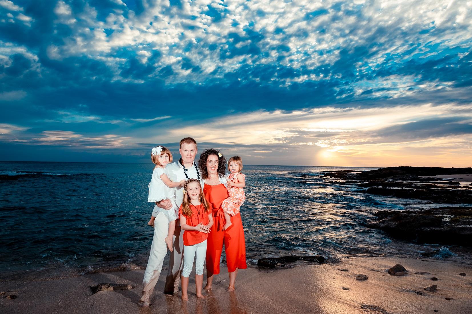 family vacation beach photos at sunset disney aulani resort oahu