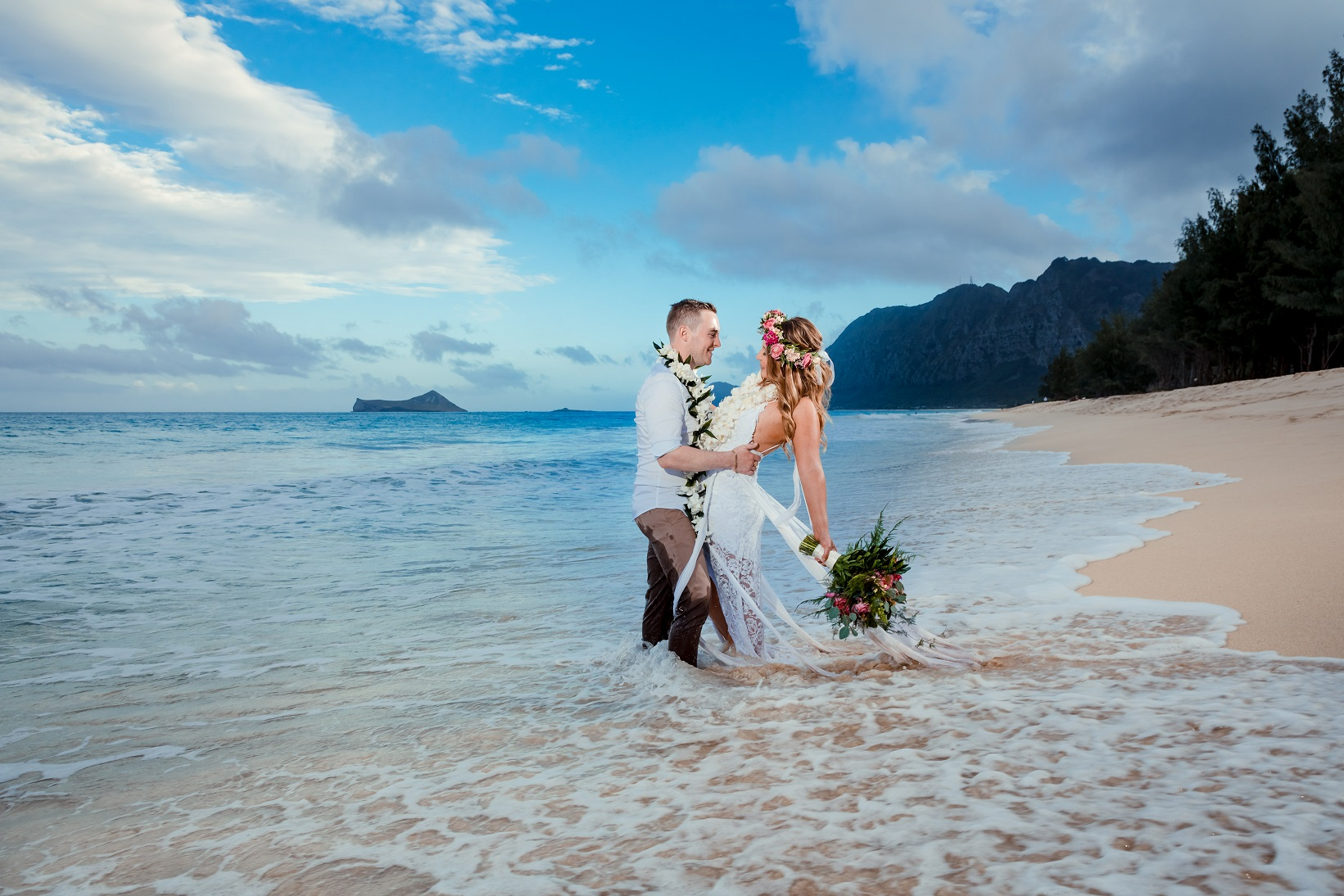 Romantic wedding portrait in the surf on the beach at sunset on Hawaii... Sigh.