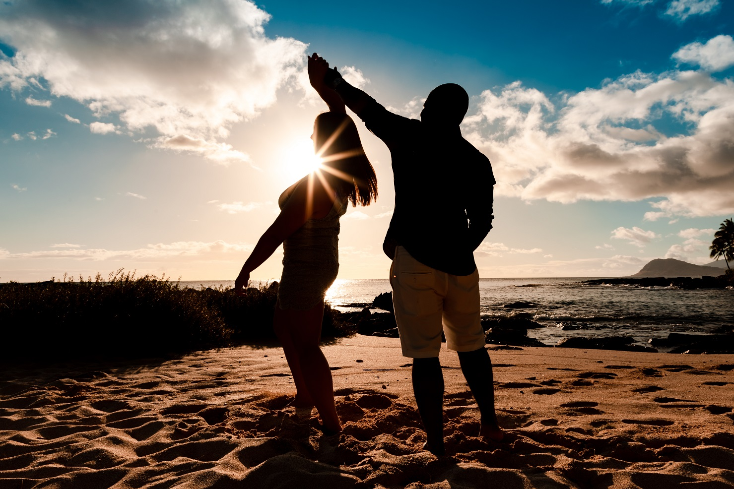 couples silhouette engagement dance secret beach ko olina