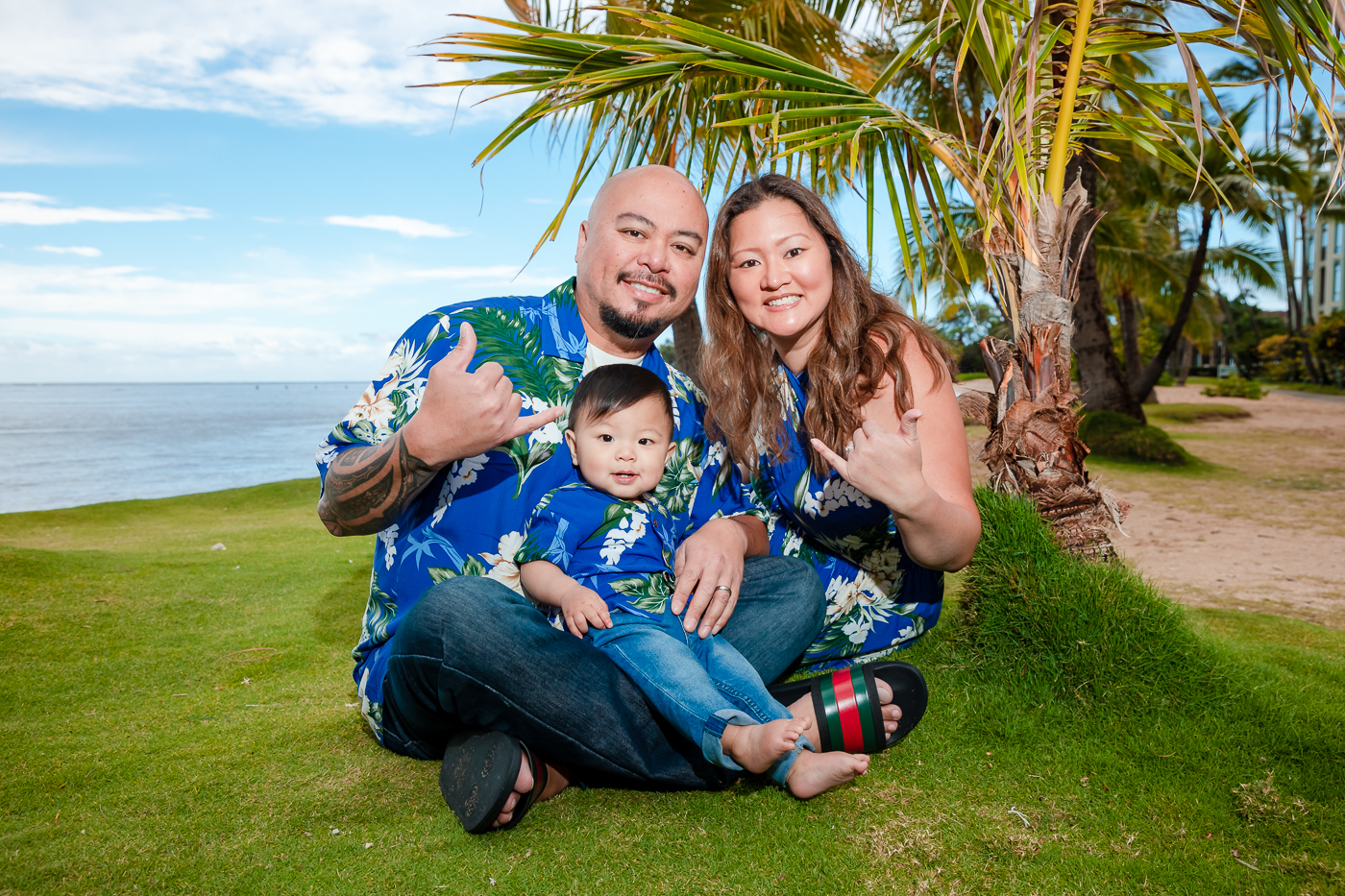 family child baby portrait grass lawn palm tree ocean oahu waikiki