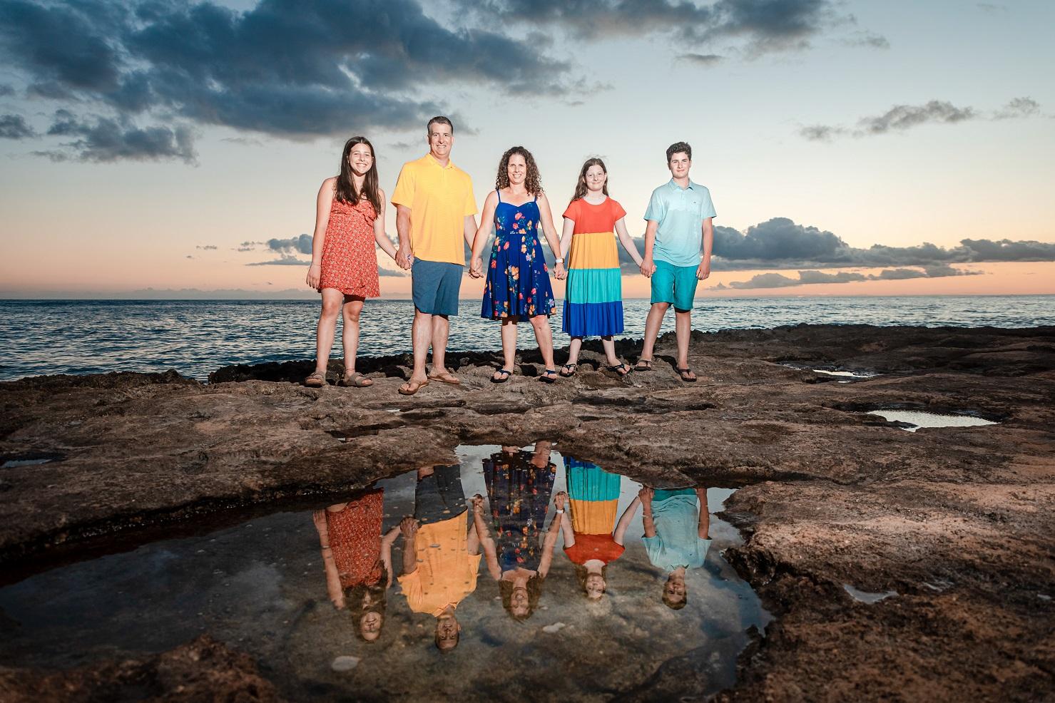 kauai family photographer sunset ocean shore tidepool reflection