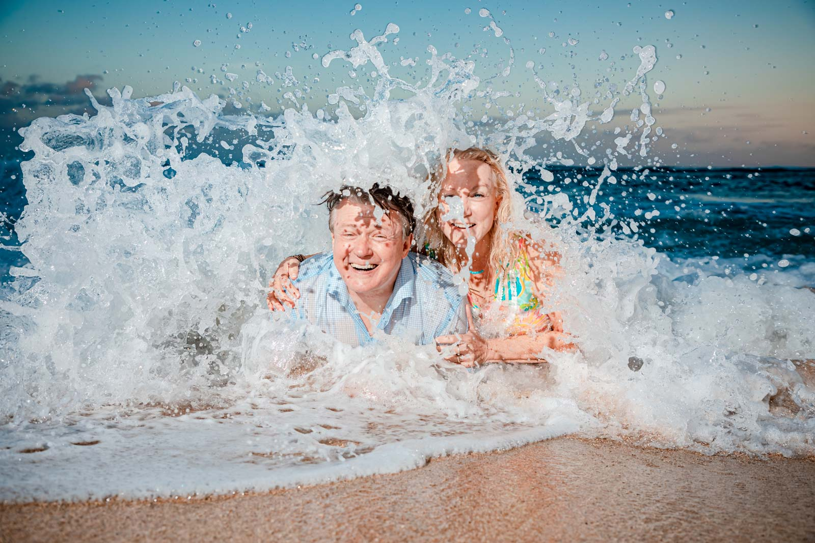 family sunset waves ocean beach kauai beach portrait