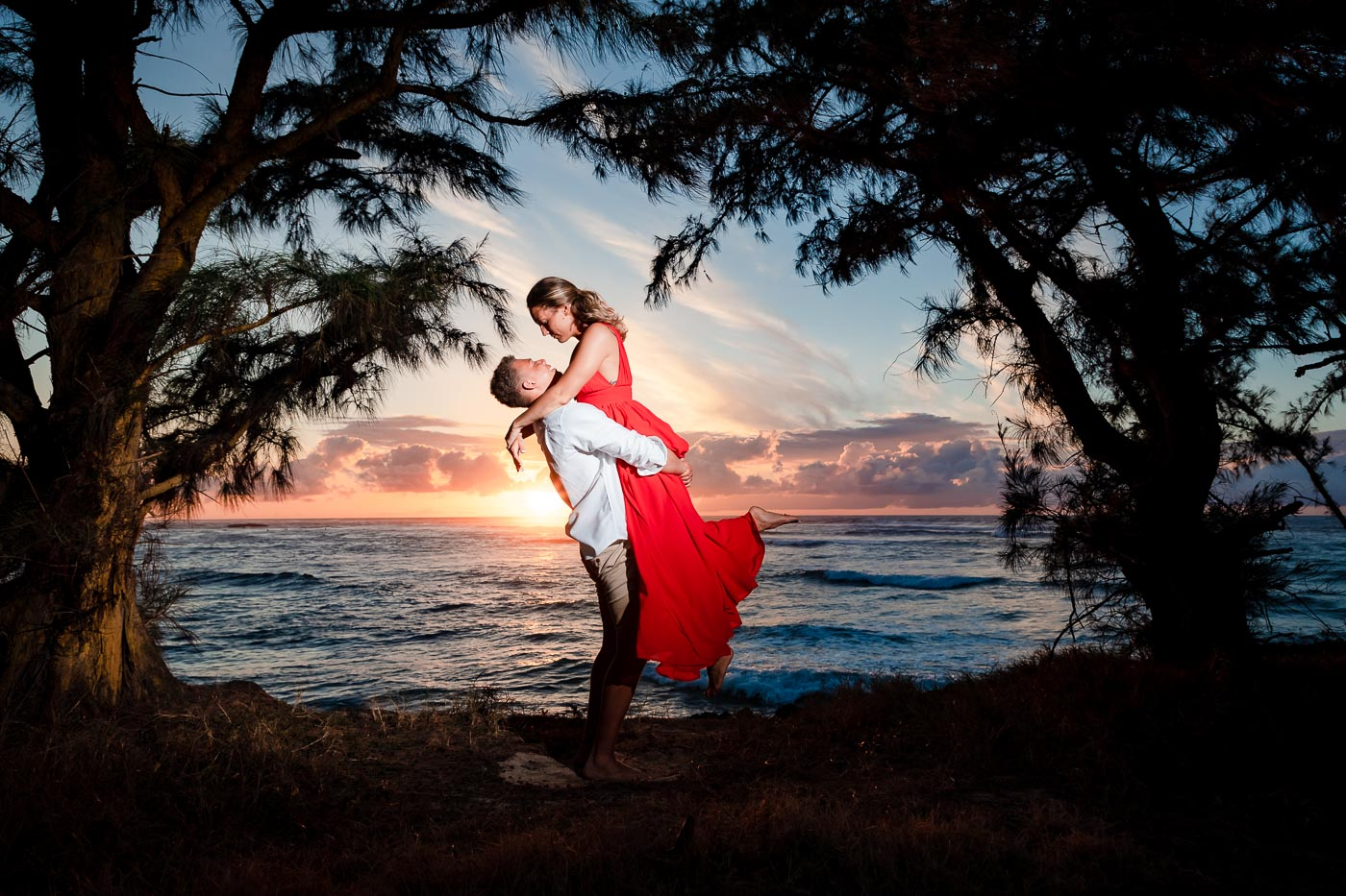 couples engagement sunset silhouette oahu north shore