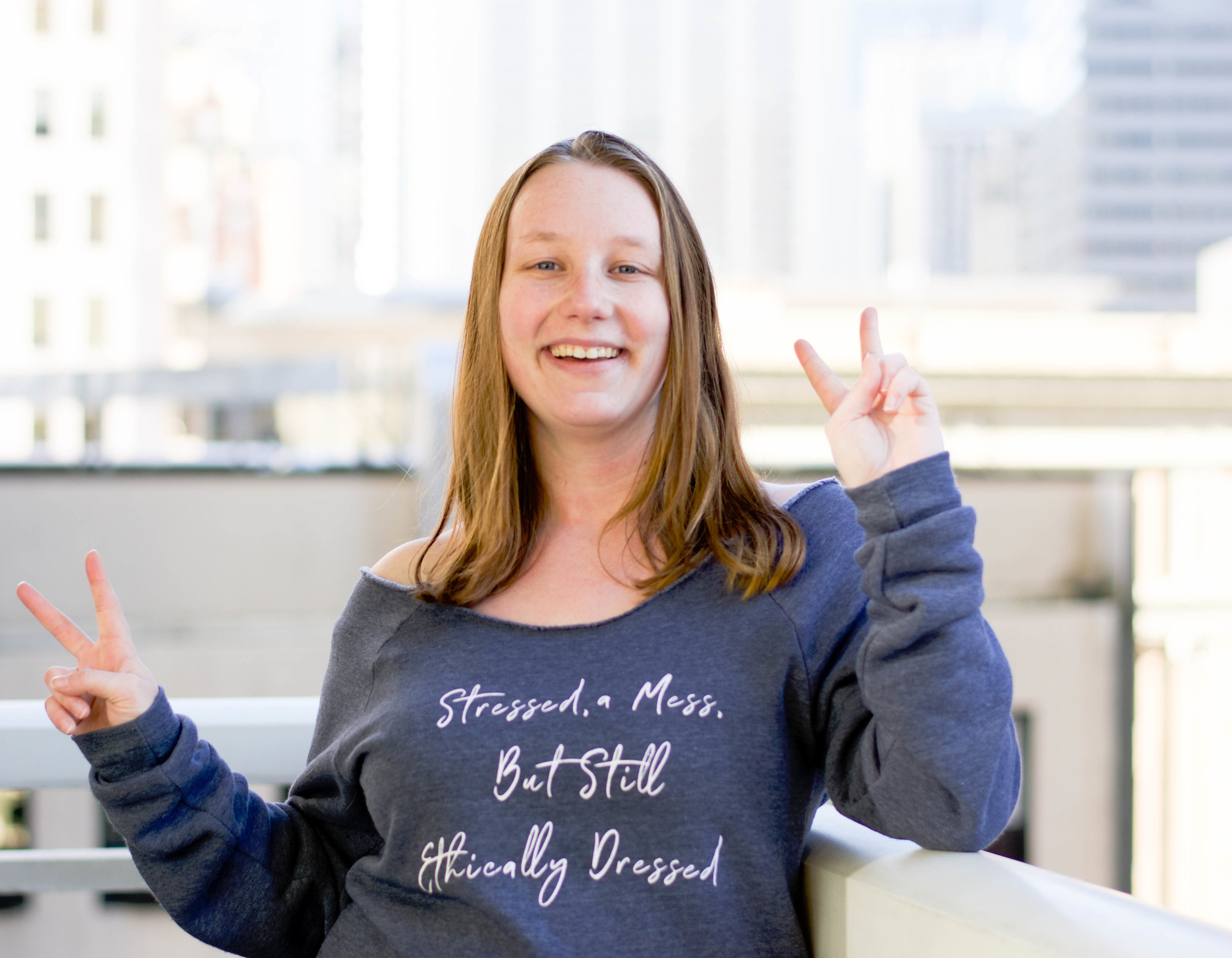 Ethically dressed in  Give a Damn Good's Stressed a Mess sweatshirt