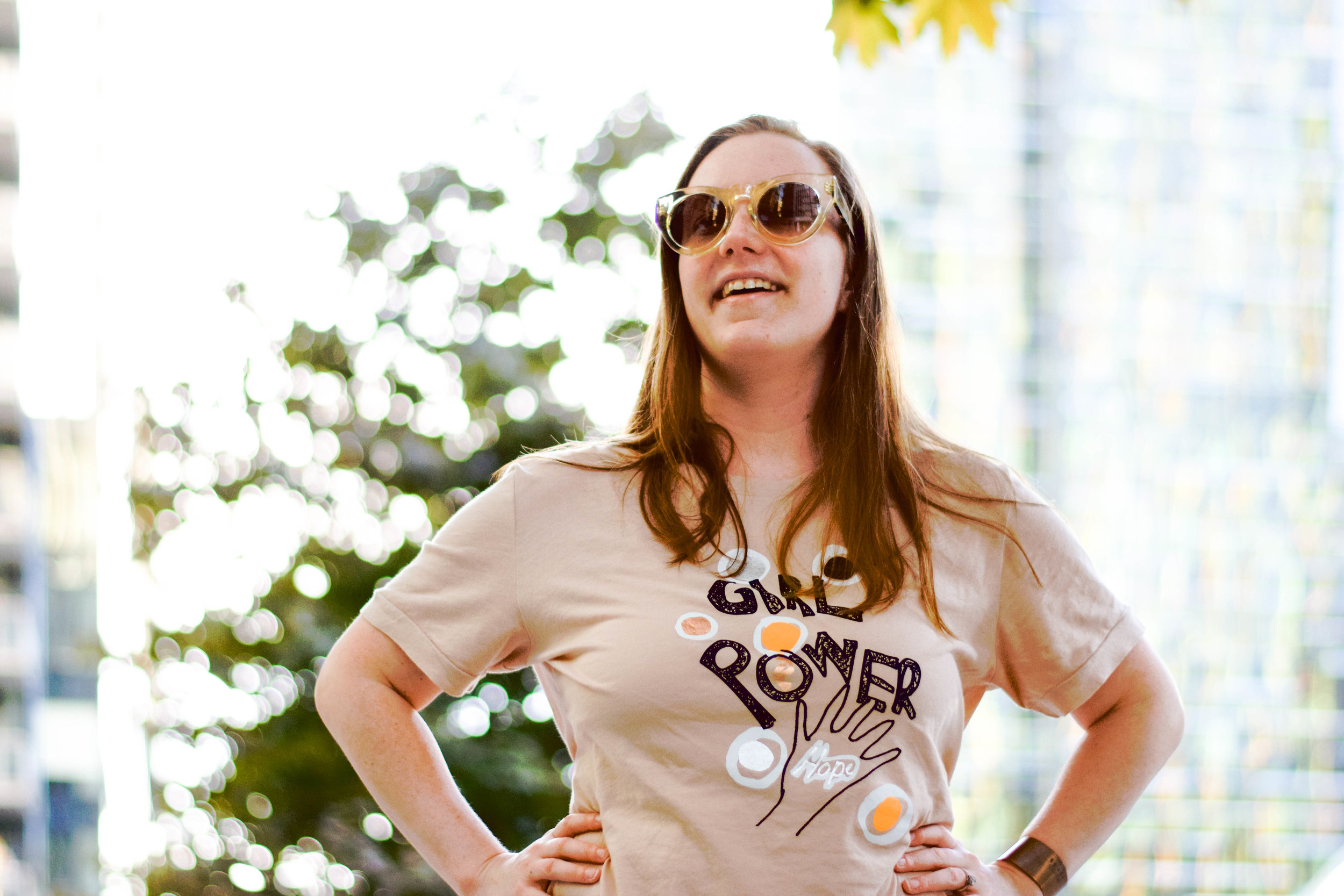 Ethically styled in:  Girl Power tee from ROUND + SQUARE ,  Medium Copper Cuff from BRANDED Collective,  &  Cleopatra Sunglasses from Dynamikos