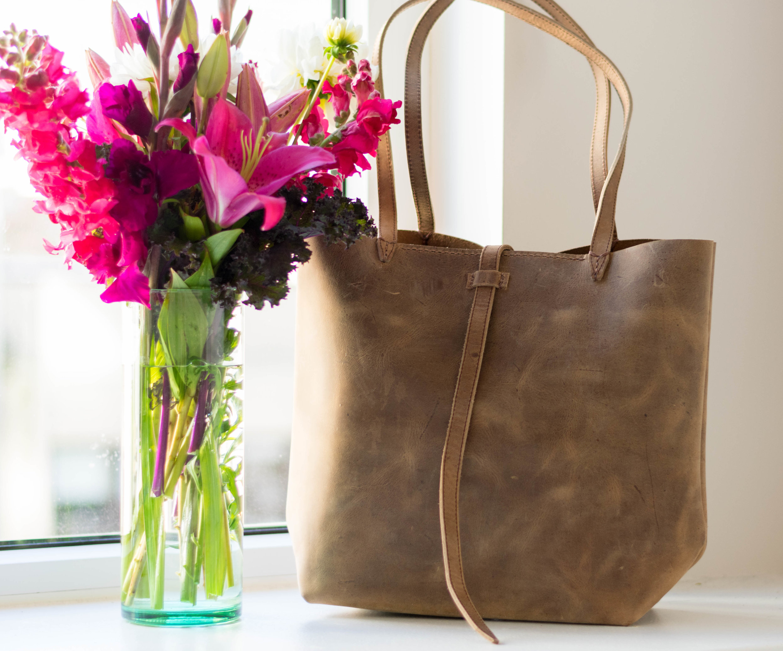Featuring Stone  Ana Julia Tote by Lazarus Artisan Goods  + recycled glass vase from  Newly