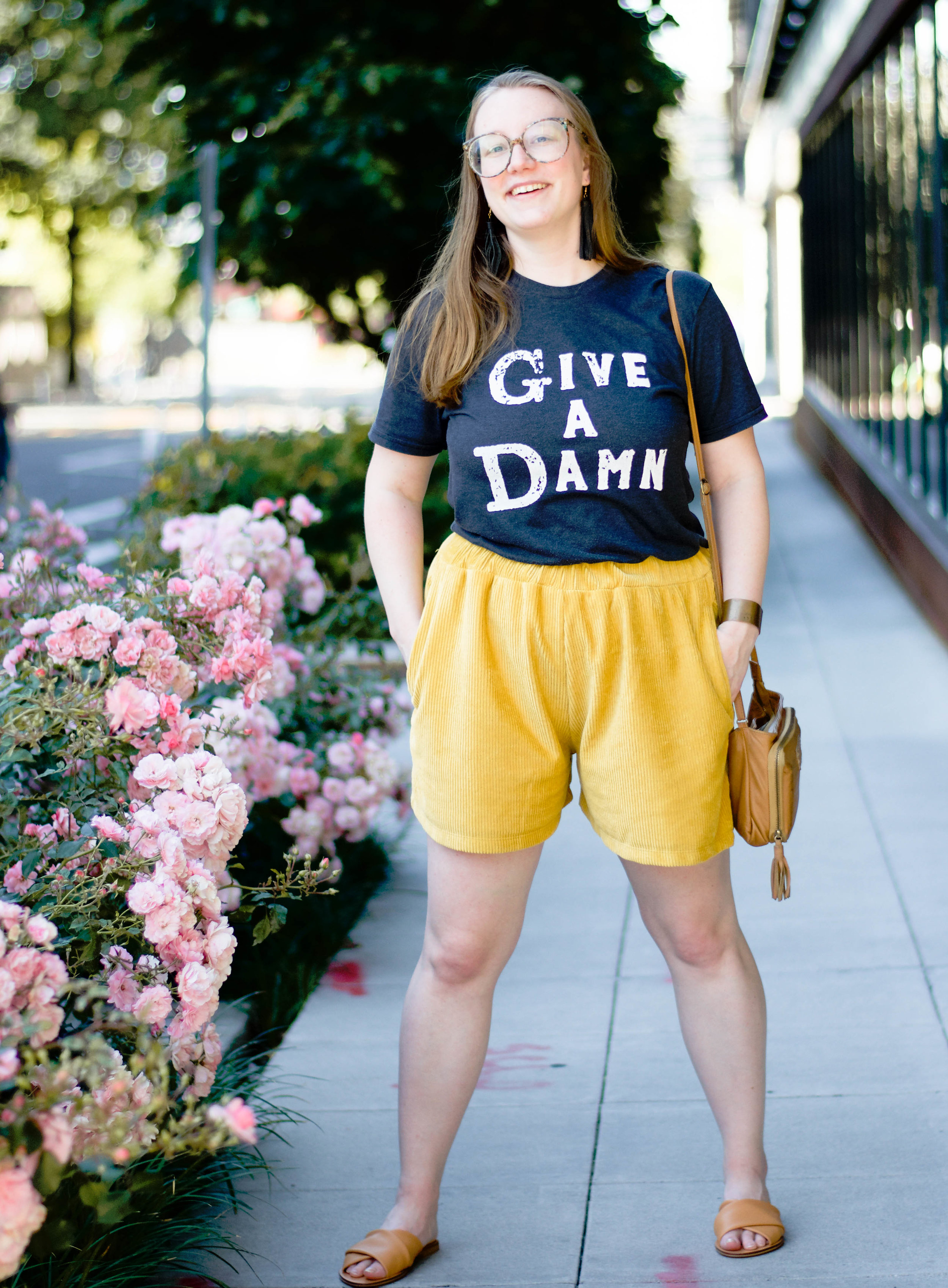 Ethically styled in  Give a Damn Classic tee  from  Give a Damn Goods  +  zero waste shorts from Tonlé  +  Leather Tassel Earrings  by HUGG +  Medium Cuff  by BRANDED Collective +  retro glasses  from  Retrospecced  + sandals from  Everlane