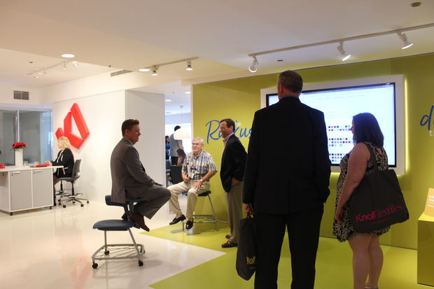 A NeoCon visitor tries out different ways to sit on the Ruckus chair. [DNAinfo/Kayla Martinez]