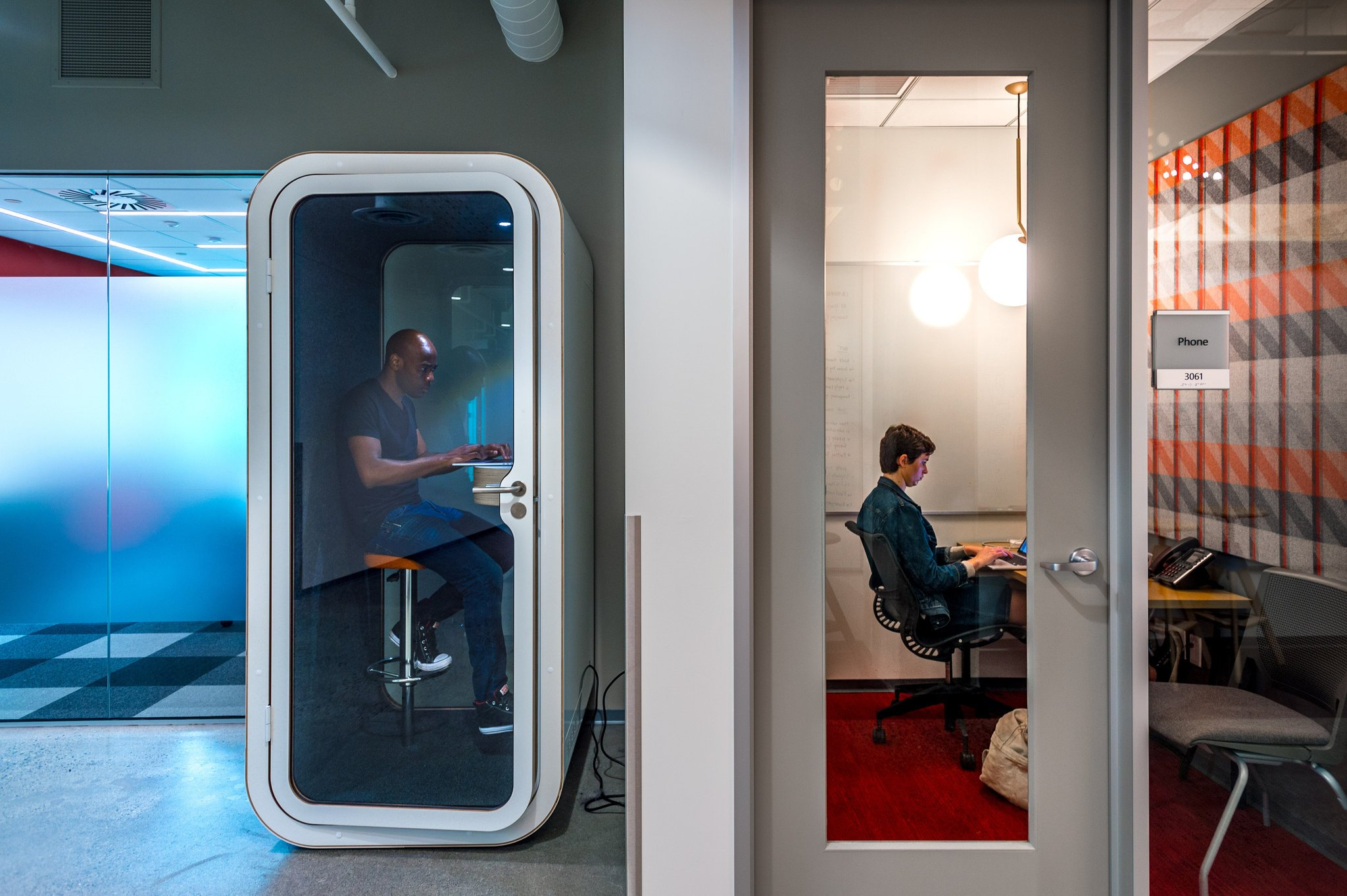 Renovated Microsoft offices have a variety of work spaces for employees. Left, a phone-booth-style room for privacy, and right, an isolation room. (Stuart Isett for The New York Times)