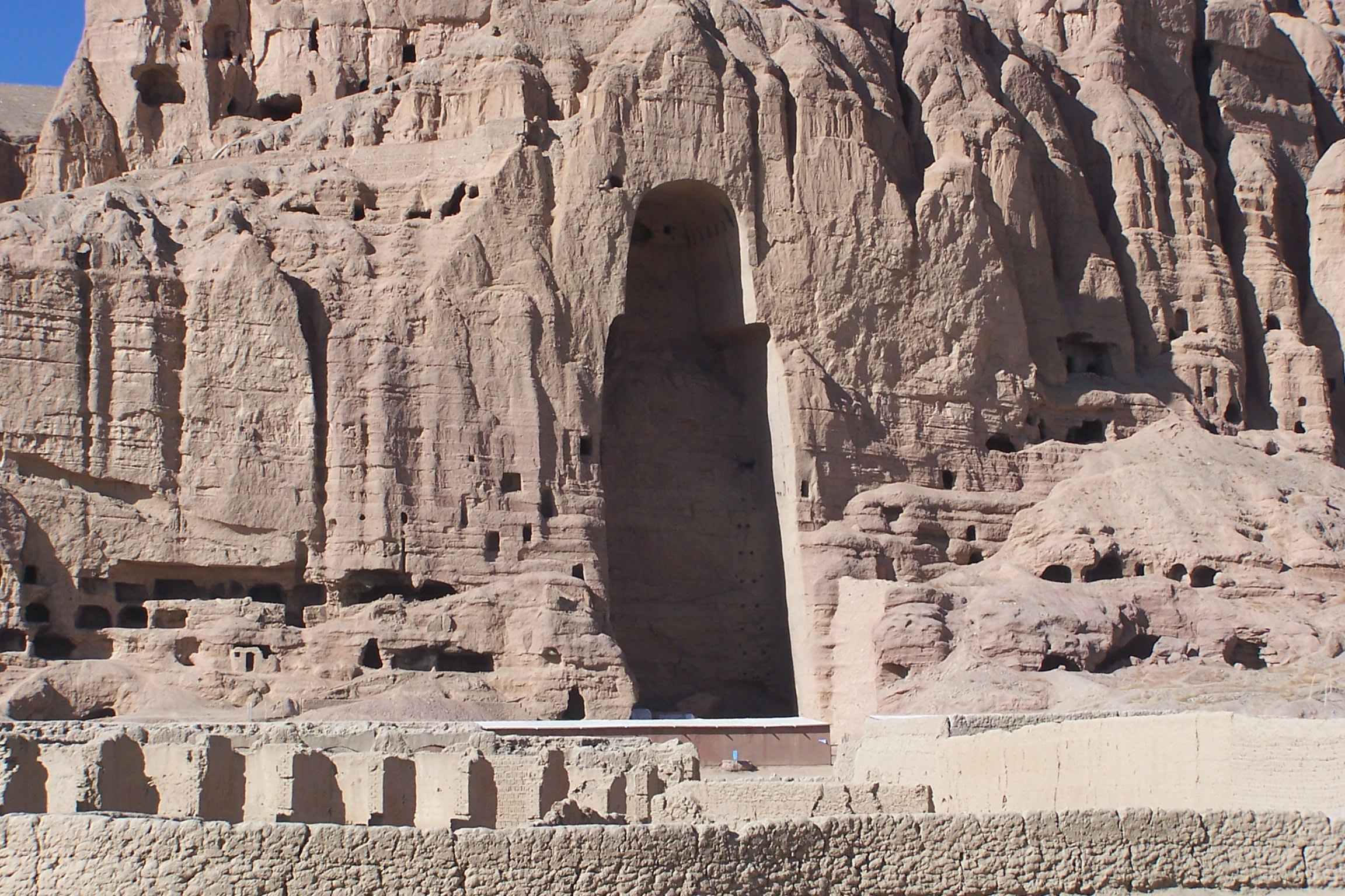 Remains of the Buddhas of Bamiyan, Afganistan © Carlos Ugarte, licensed under  CC BY 2.0  and adapted from the original