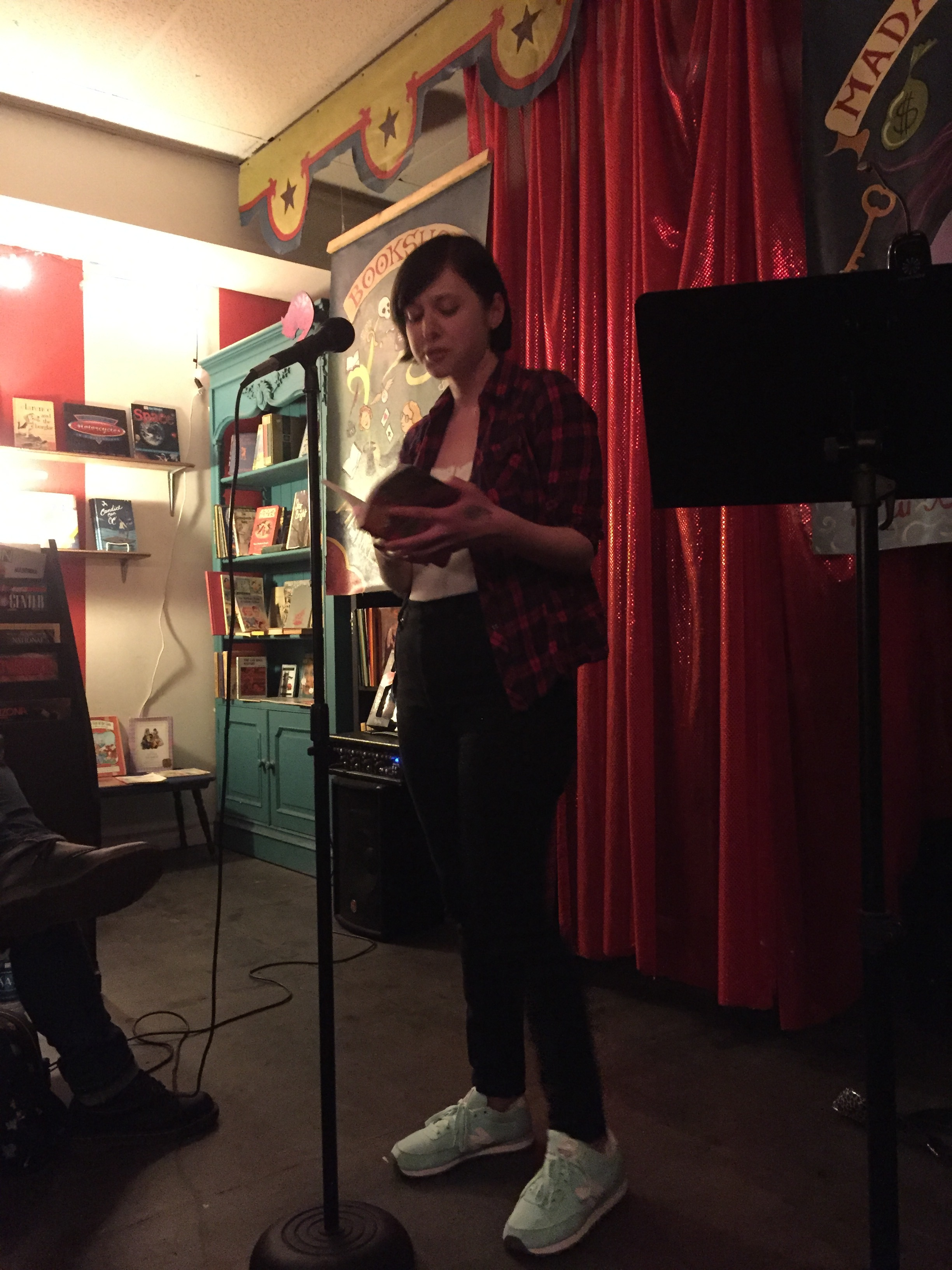 """Reading from my essay """"The United States of Rape Culture."""" Photo by Alex Villa."""
