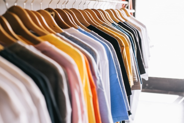 clothes-rail-with-t-shirts_23-2147669592.jpg