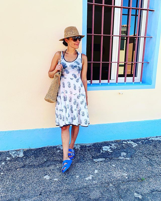 The vibrant colors of the streets of Sardegna.  I know I look very extra posed 😂 but Chloe actually snapped this while we were just hanging in the shade outside the boat tour place - thanks my little photographer. 💙 Love this dress I found in the picturesque little town of San Pantaleo where there are so many unique shops. A must visit for anyone visiting Porto Cervo.  #sardinia #sardegna #portocervo #sanpanteleo #travel #familytravel #beautifuldestinations #explore #italy #italia #localshops