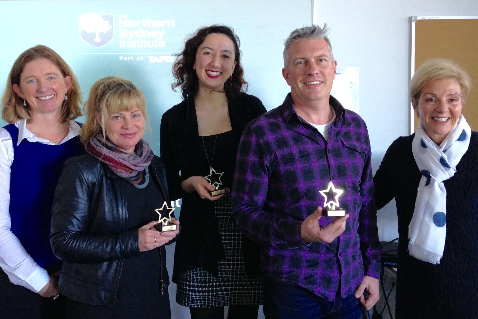 The winners of the elevator pitch challenge with their coveted trophies!