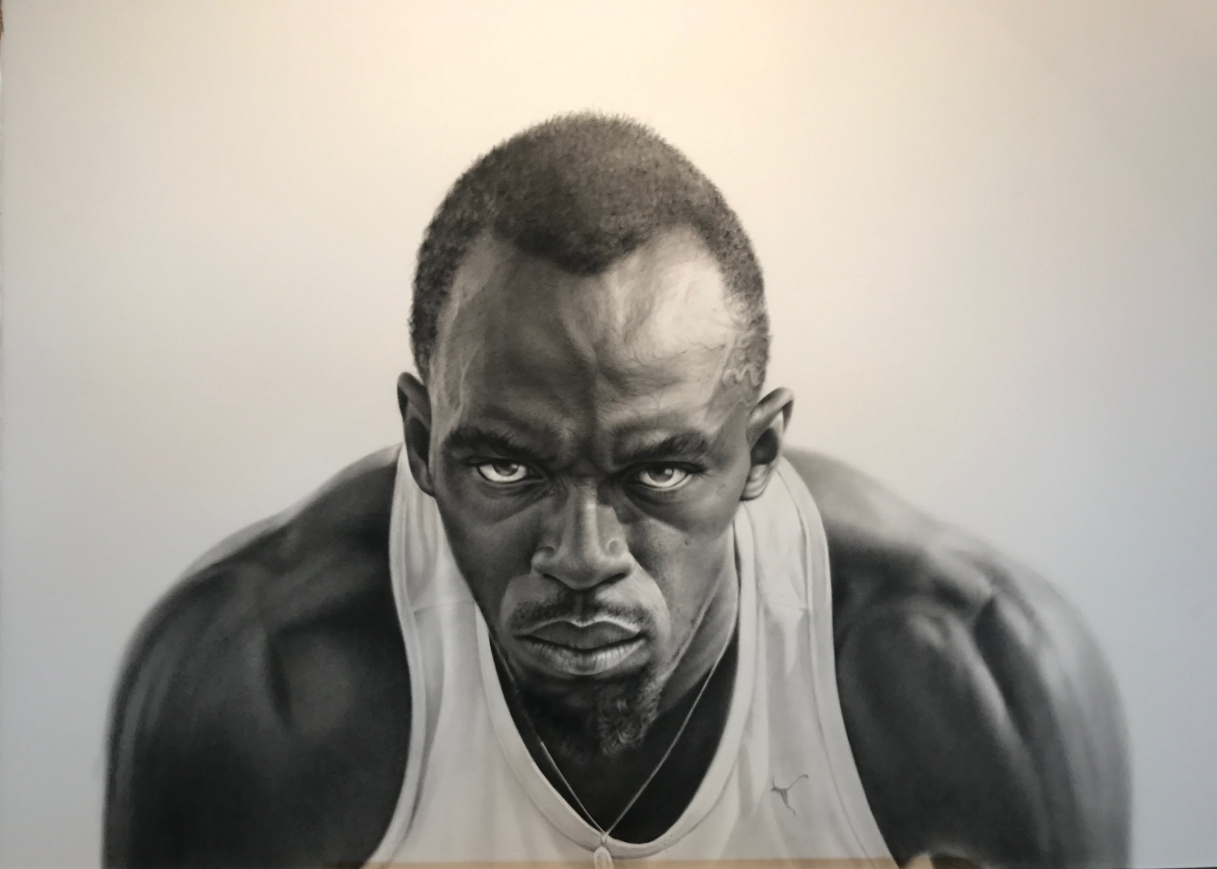 Charcoal portrait of Usain Bolt - The Greatest sprinter of all time. I am a runner and an artist and the fastest man on earth inspired me to paint his portrait. I met Usain Bolt when he was visiting Melbourne competing and team captain of the Bolt All- Stars at Nitro Athletics Melbourne.