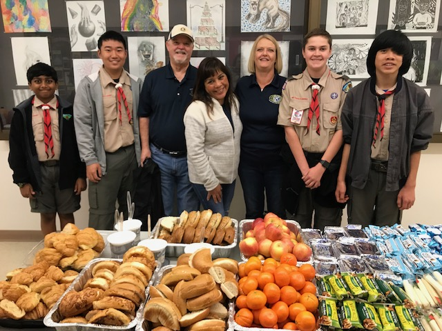 Kiwanians and Troop 805 Scouts working the YOUTH-TO-YOUTH Conference at Cal High on 3/23