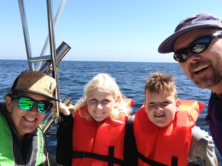 Best thing about fishing -Leslie enjoying it with her brother, niece and nephew.