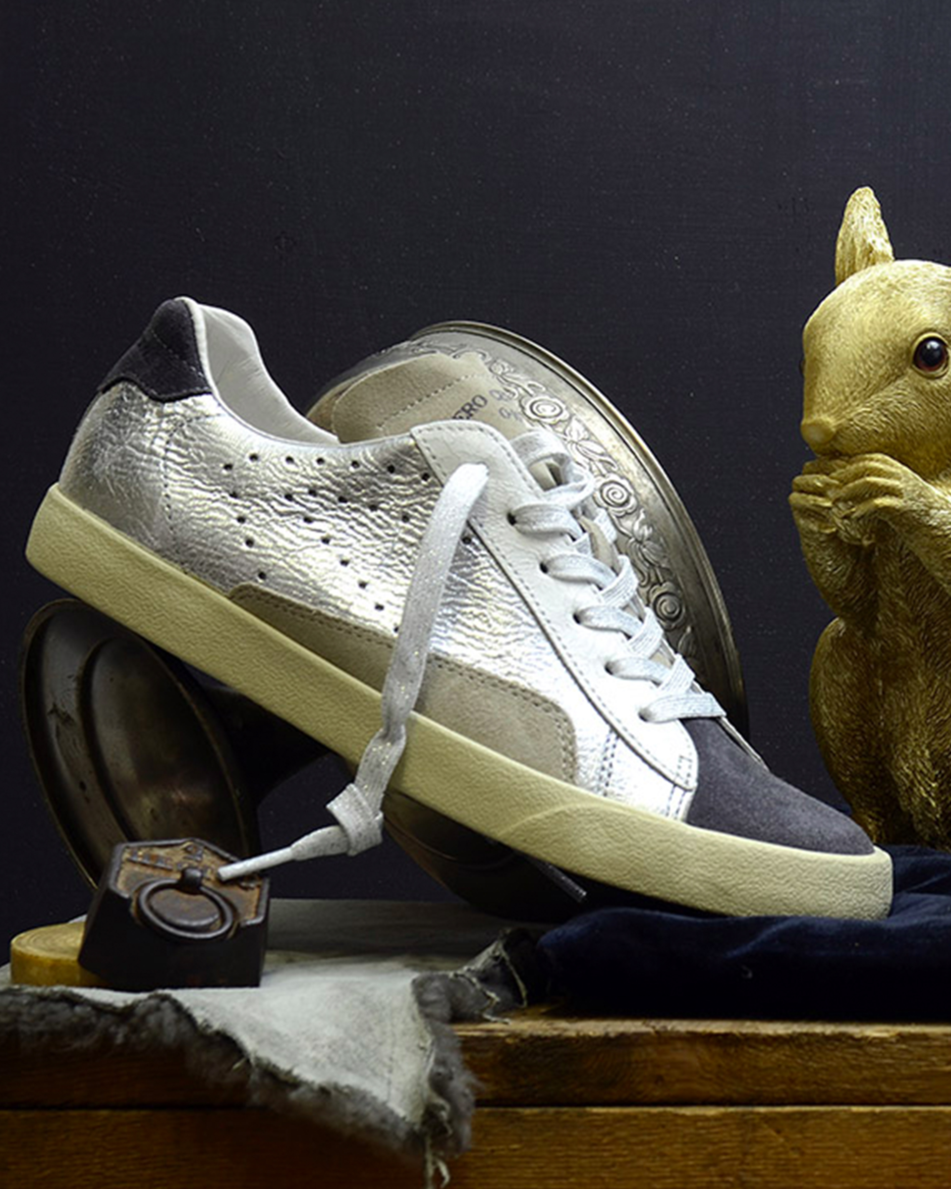 0-105 - Established in Marseille in 2012, 0-105 takes inspiration from contemporary culture, vintage, art, street style and the beauty that lies in imperfection…The label expanded quickly from a small recycled vintage line to a modern sneaker collection.Today, 0-105 sneakers, a luxurious interpretation of the most iconic «basket » silhouettes, are carefully crafted from the finest leathers and finished with subtle signature, for a timeless stylish sneaker.