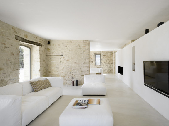 I love the exposed 300 year old farmhouse masonry with the smooth resin floor and calming interiors. Personally, I'd have added some colour but this sanctuary is a great example of a successful marriage of old and new. Casa He, Italy