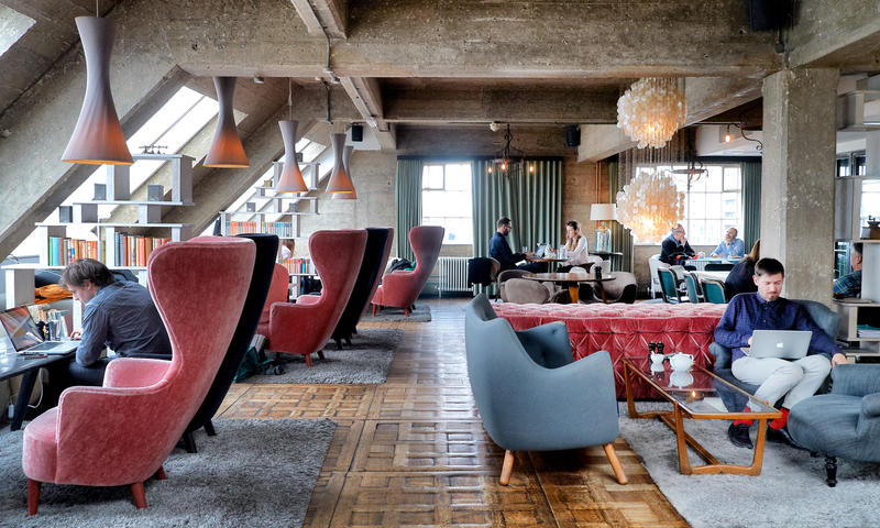 Converted warehouse Sitting Room featuring Tom Dixon furniture and a mixture of antique and contemporary light fixtures. Shoreditch House, London