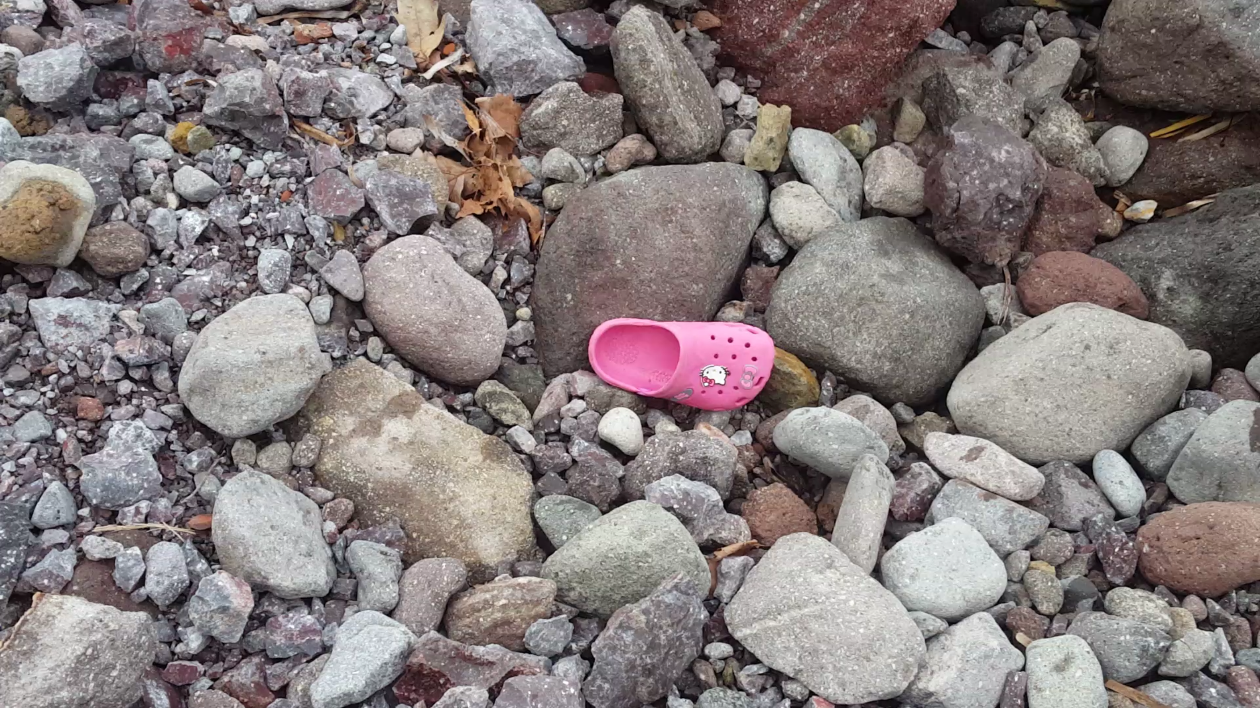 A photo of a child's pink Croc found on Lighthouse Beach where hundreds of thousands of refugees have come ashore on the Island of Lesvos, just a few feet away from the same body of water where thousands lost their lives trying to reach Europe, has become a symbol for us.