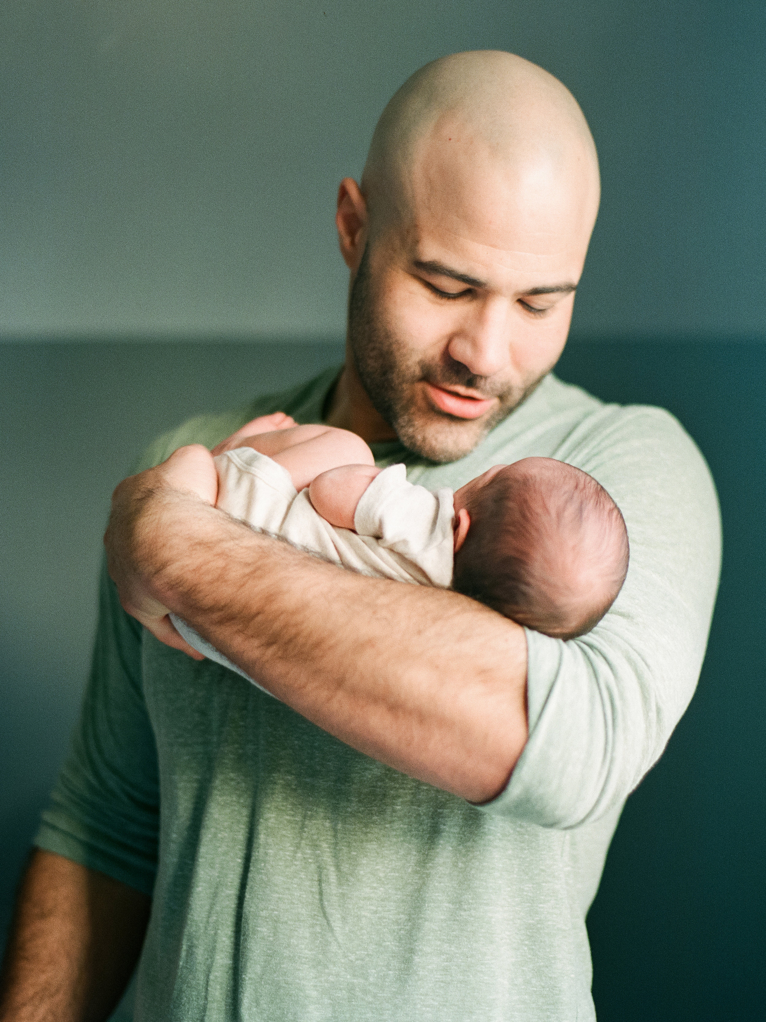 lifestyle-newborn-film-photographer-nursery-raleigh-father