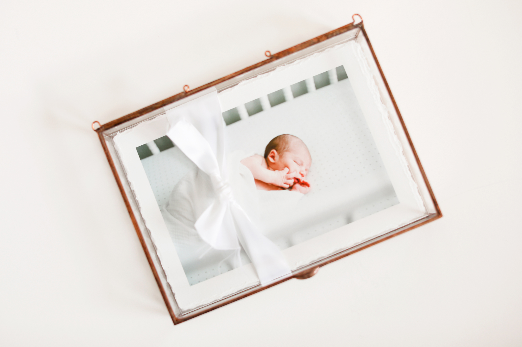 raleigh-lifestyle-newborn-film-photographer-albums-baby-books-004