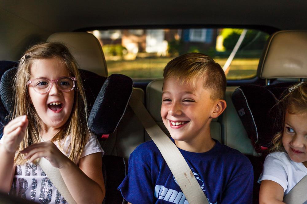 Three kids dancing in the car!